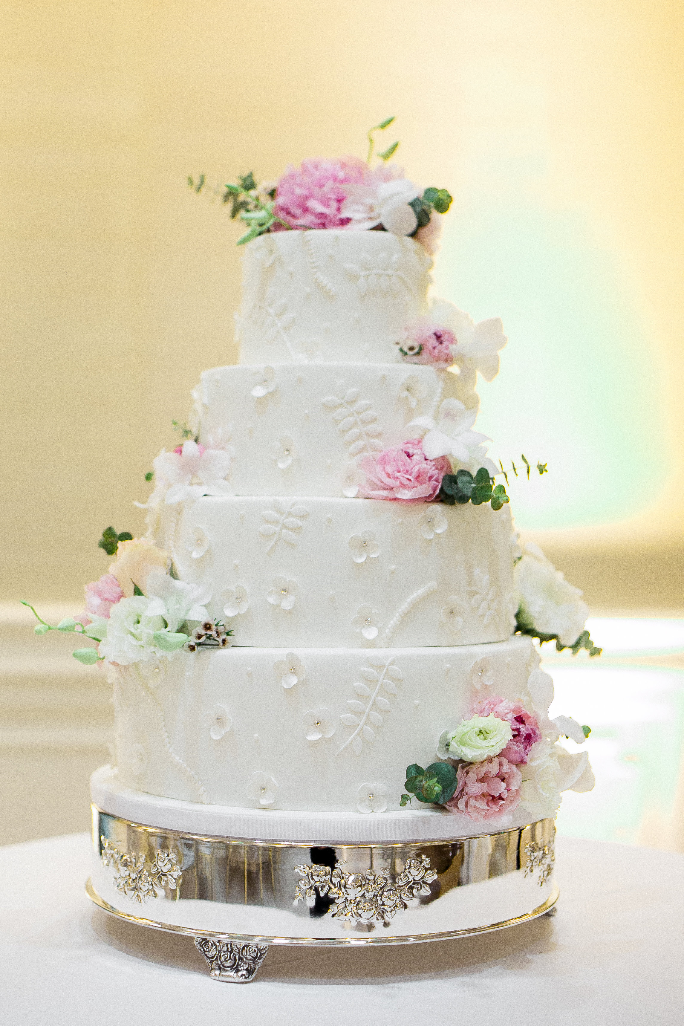 shadee and courtlan wedding with cluster events cake.jpg