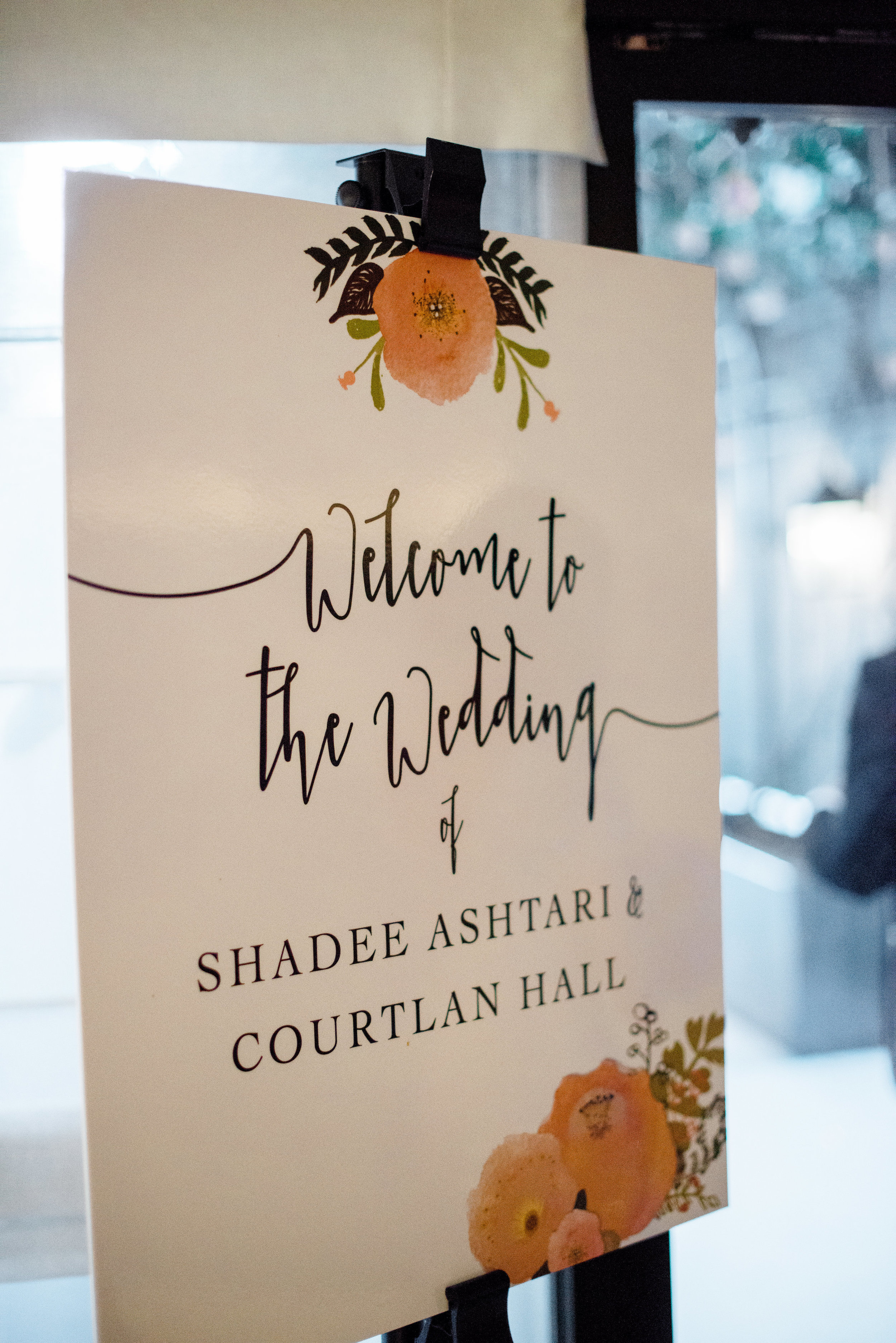 shadee and courtlan wedding with cluster events sign.jpg