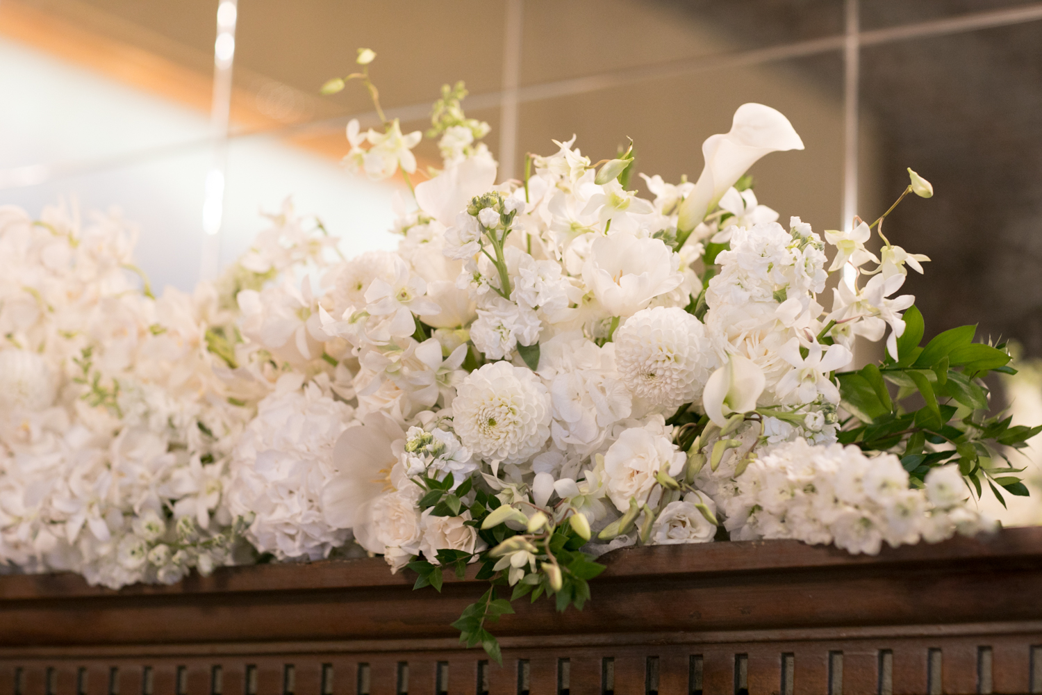 shelby and tyler wedding with cluster events floral agains.jpg