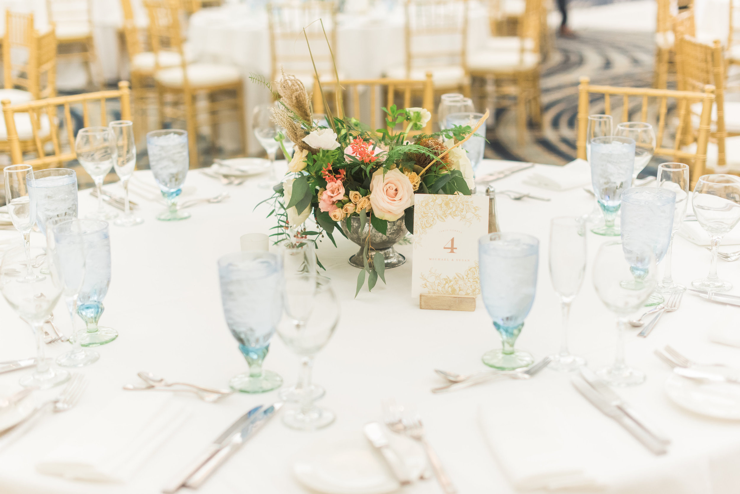 susan and michael wedding with cluster events table setting.jpg