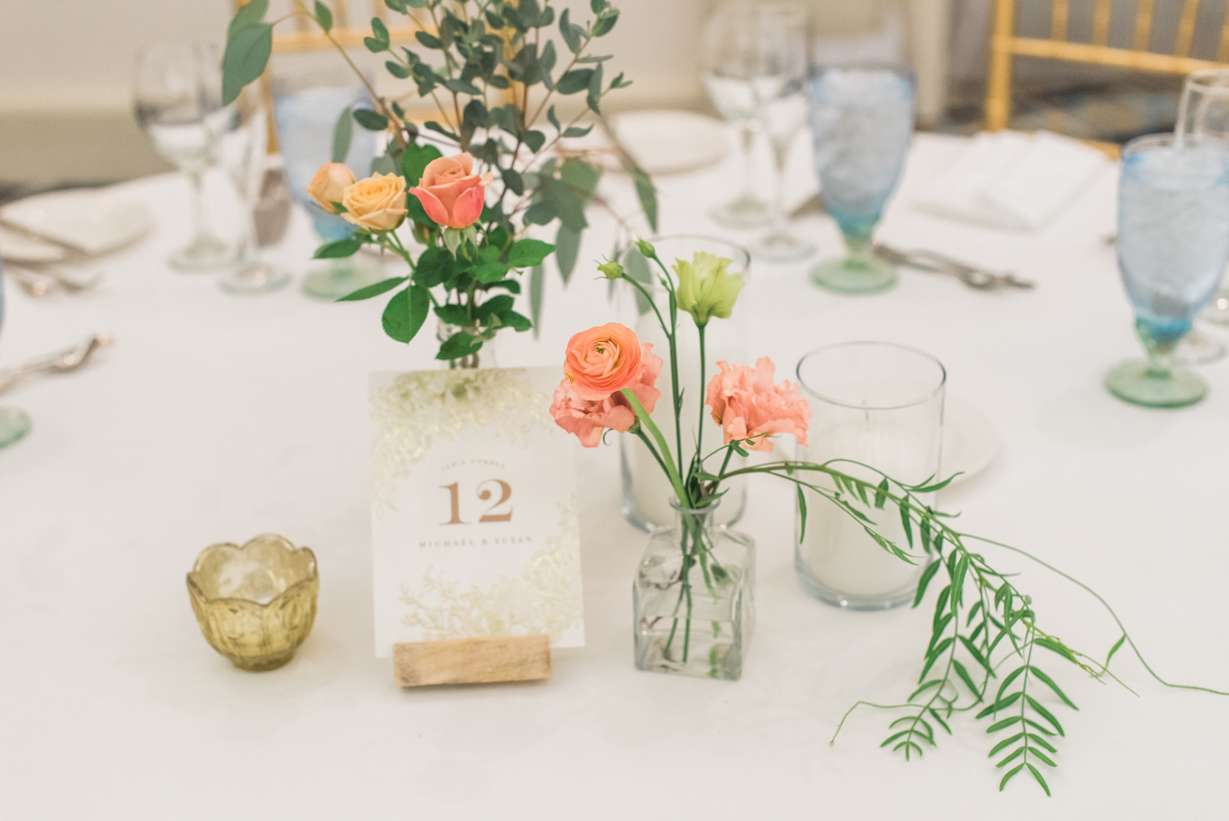 susan and michael wedding with cluster events table flower.jpg