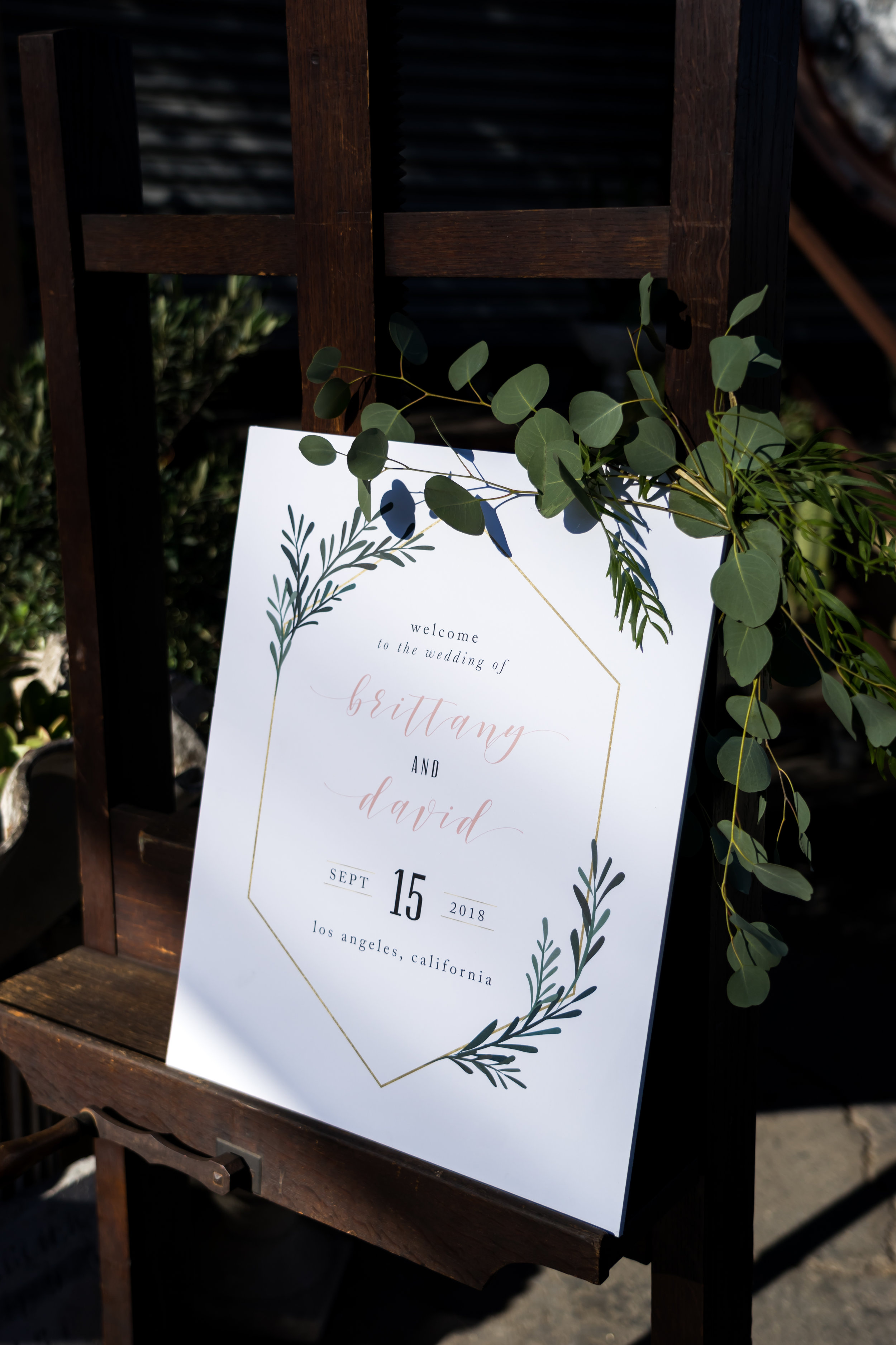 brittany and david wedding with cluster events signage.JPG