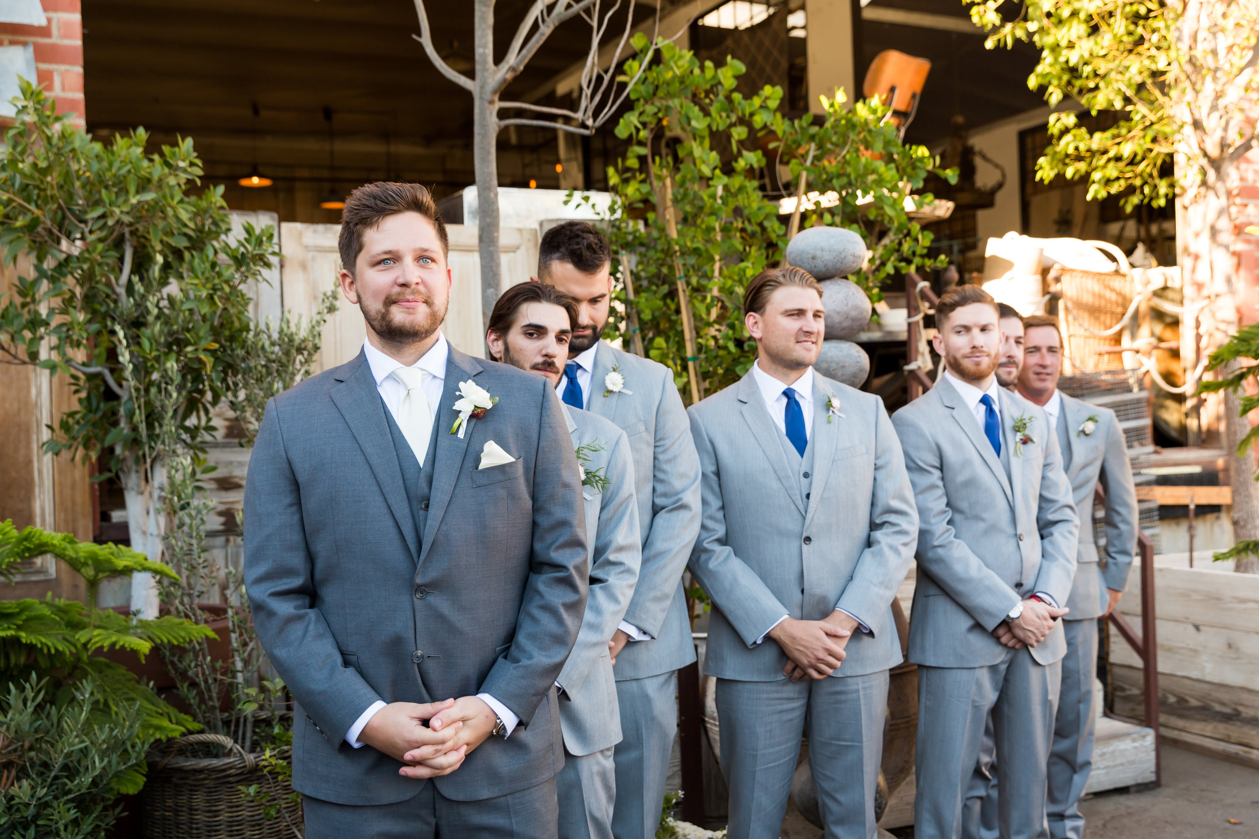 brittany and david wedding with cluster events groomsmen.JPG