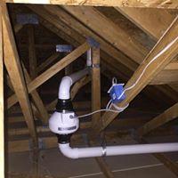 radon mitigation system in garage attic.jpg