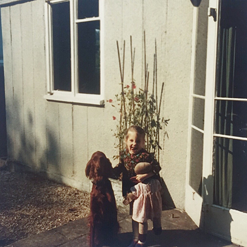 Aged about 4 with our dog Kimmy and my rag doll which was called Dolly