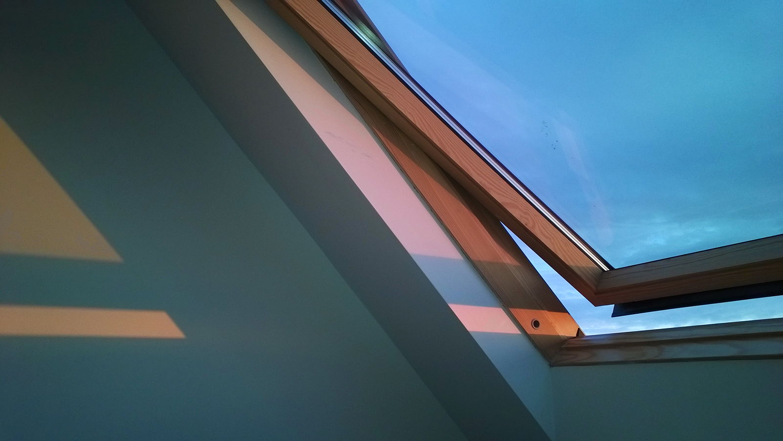 Sunset through velux window, Brighton, UK. Photograph by Tanya Clarke