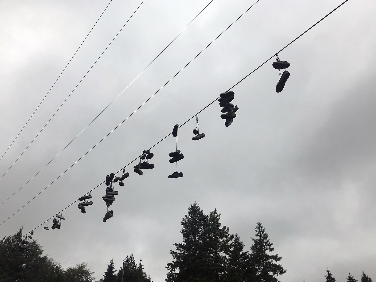 Shoes hanging from a wire, Tofino, Vancouver Island 2019 - photo by Tanya Clarke
