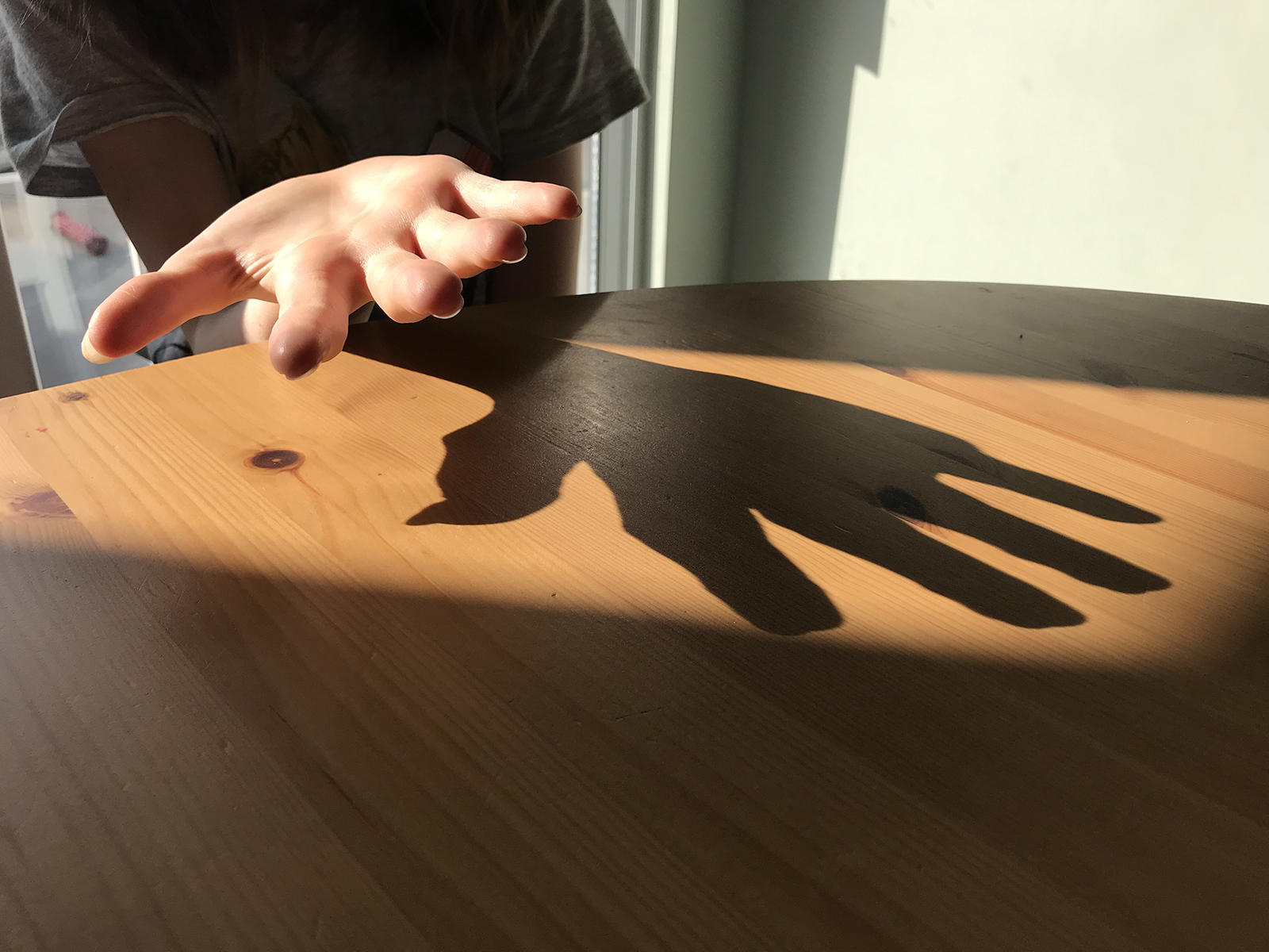 Hand shadow on table