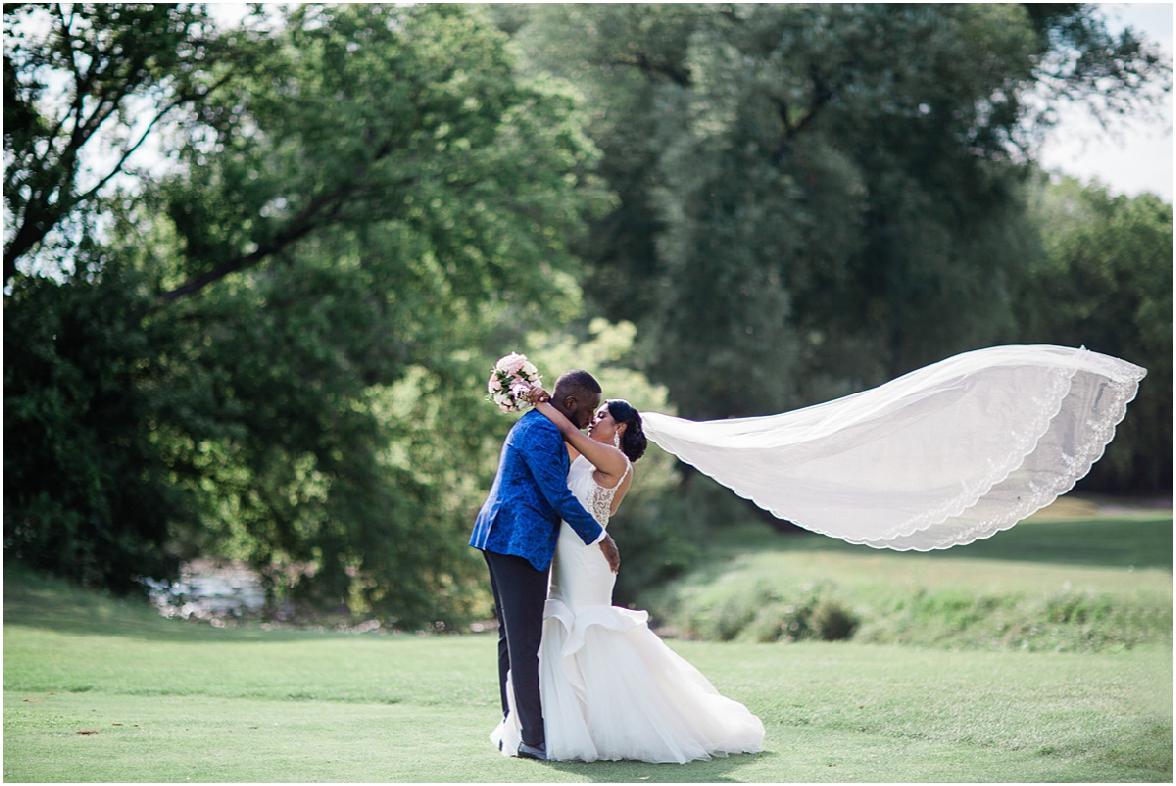 bride and groom dramatic veil