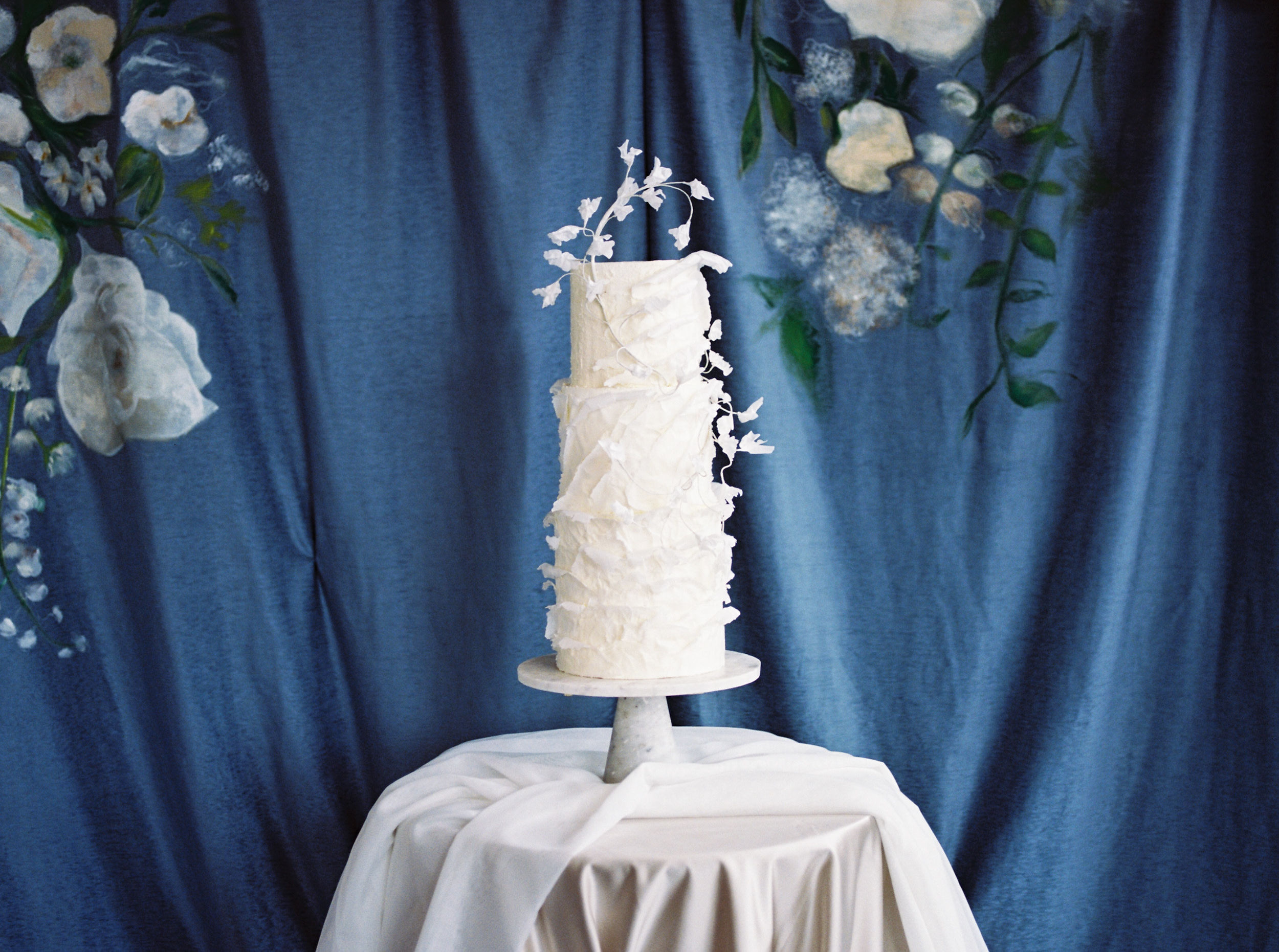 white wedding cake with floral accents