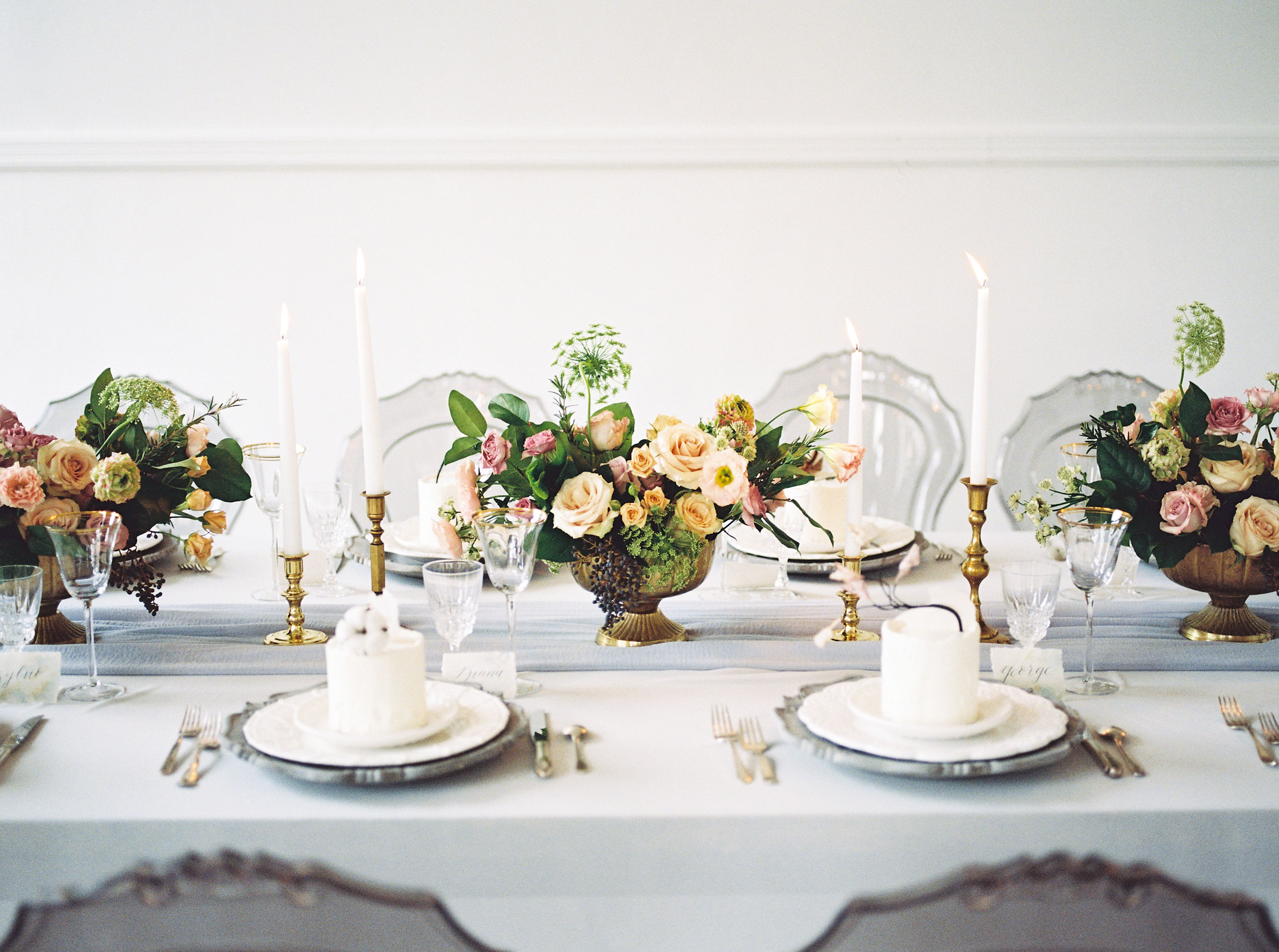 modern table setting with blush and pink center pieces