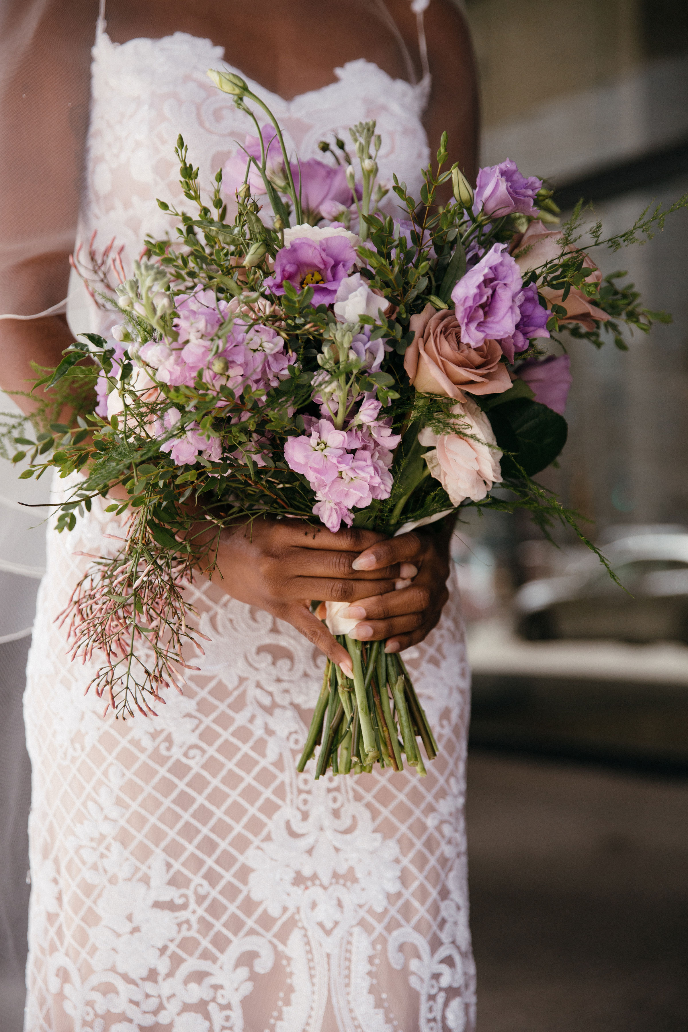 African American bride with lilac bouquet