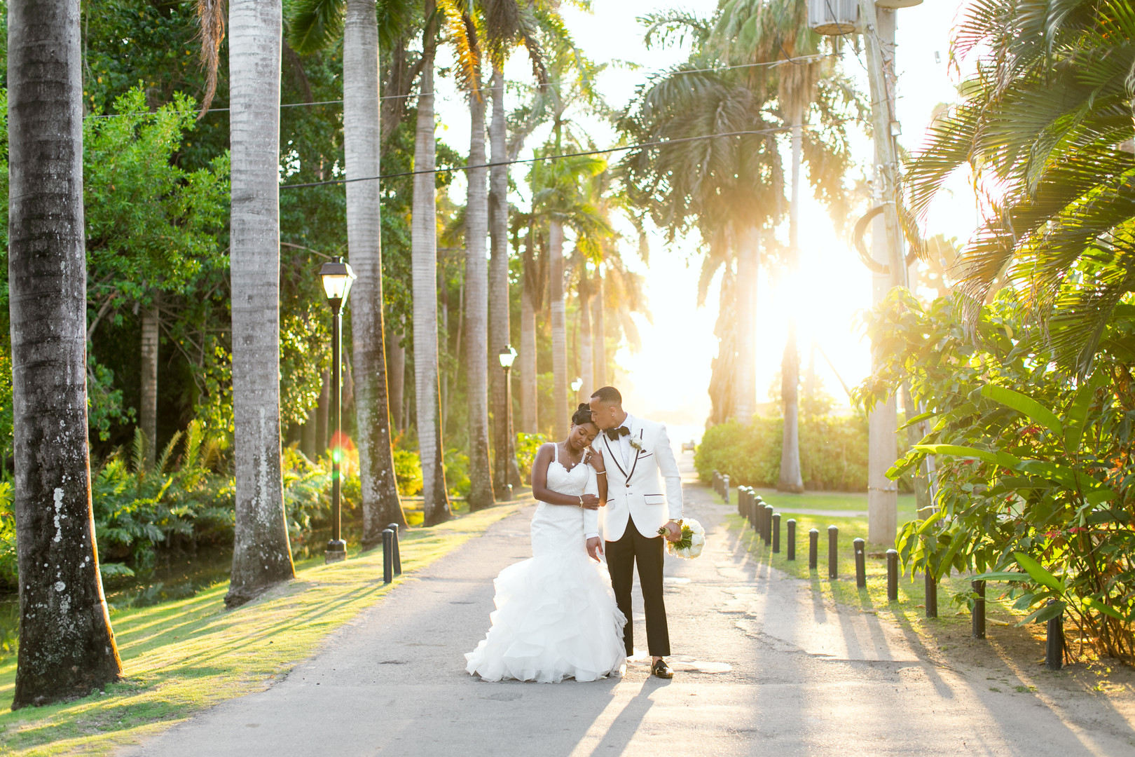 black bridal couple near palm trees