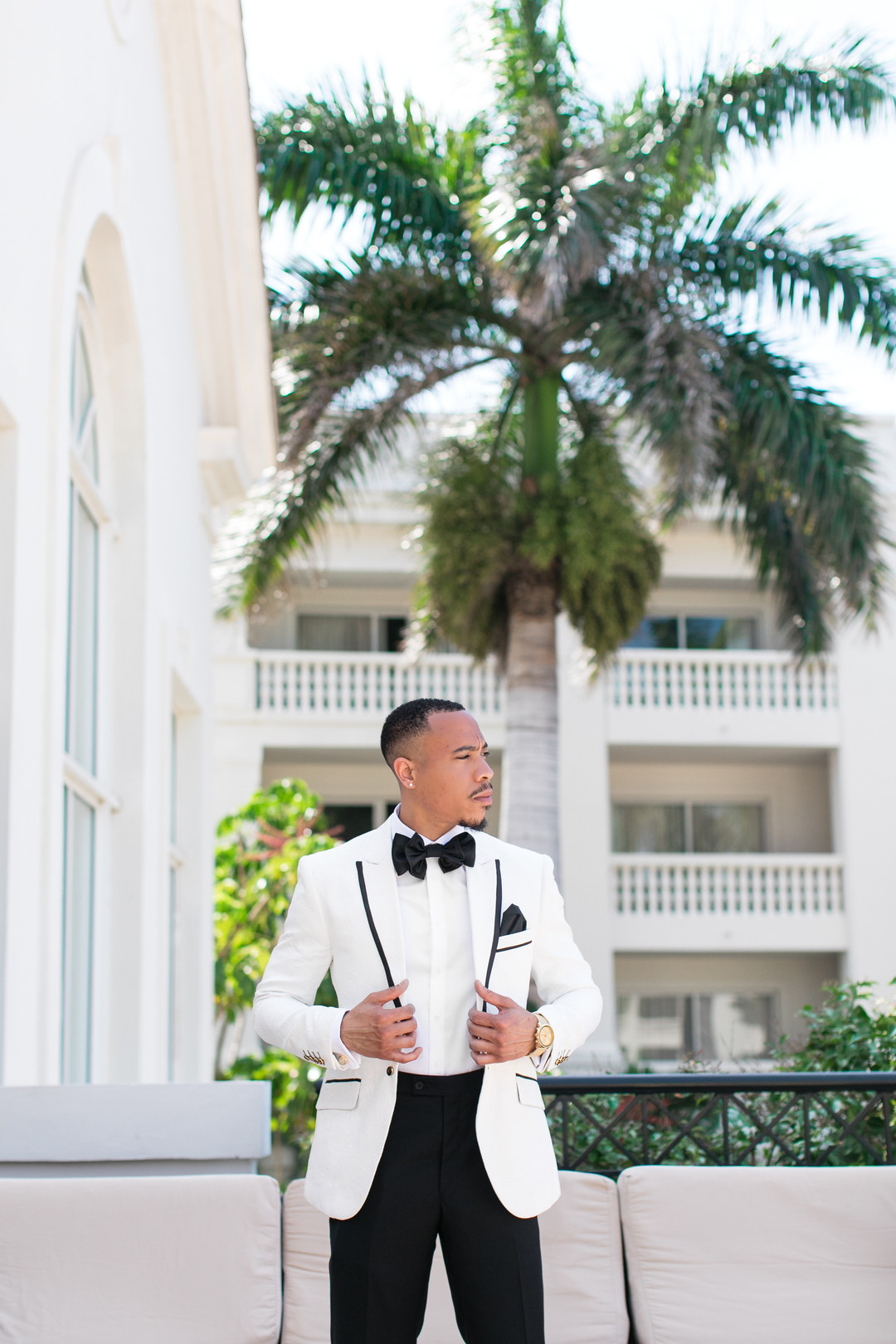 Black groom in white tux