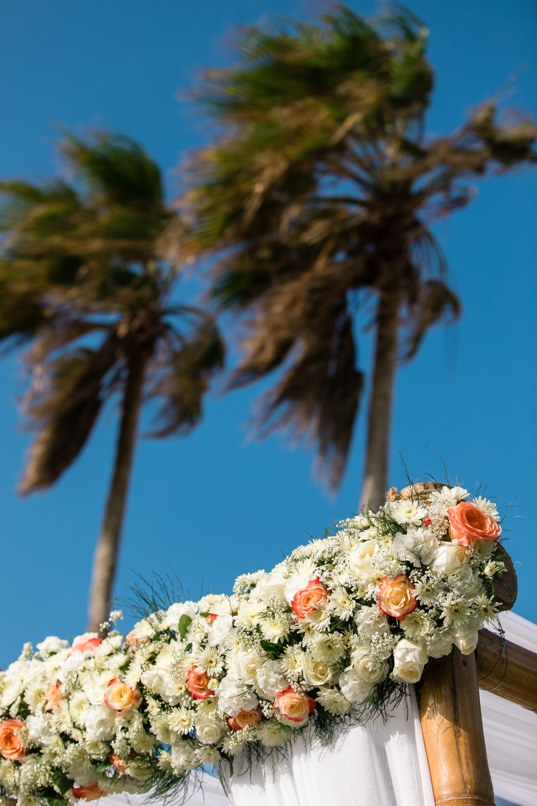 flowers on wedding arch