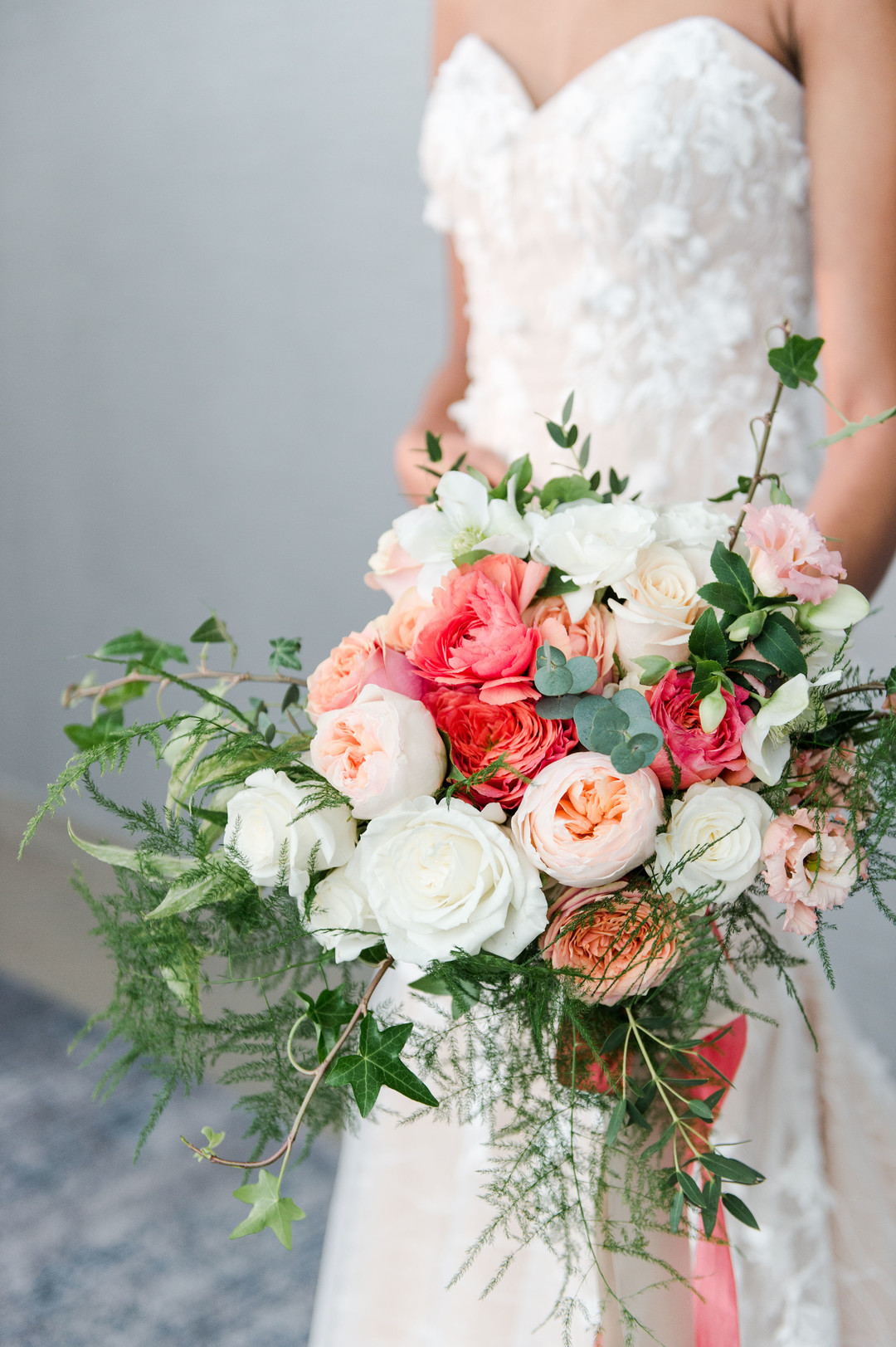 beautiful bouquet with blush and coral blooms