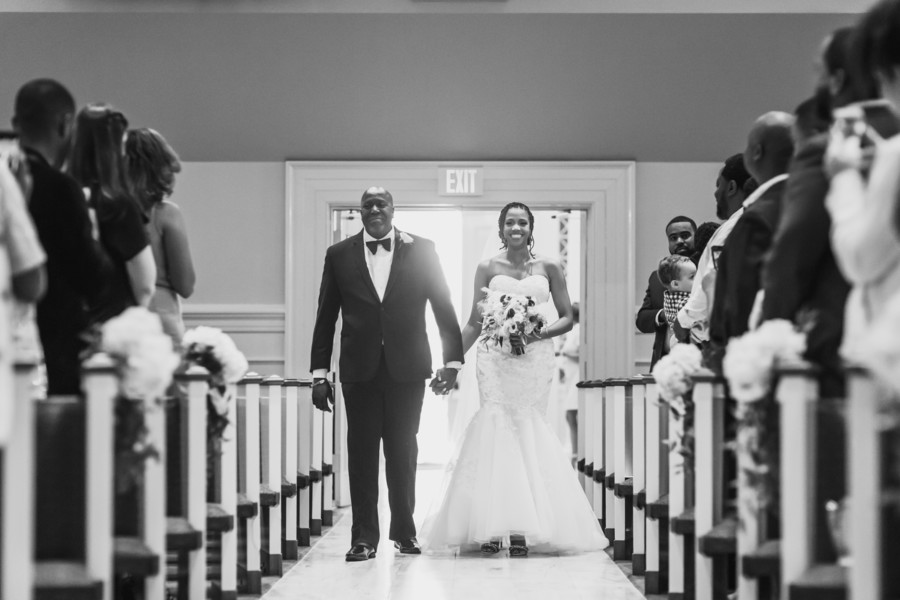 father walking bride down the aisle black wedding