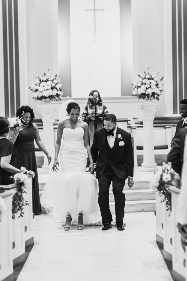 bride and groom jump the broom