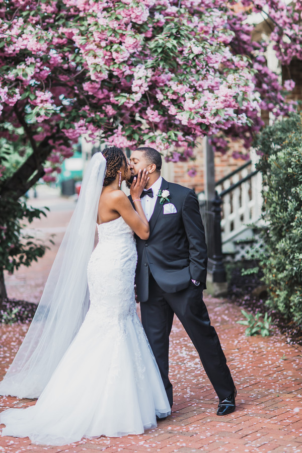black couple under trees in full bloom