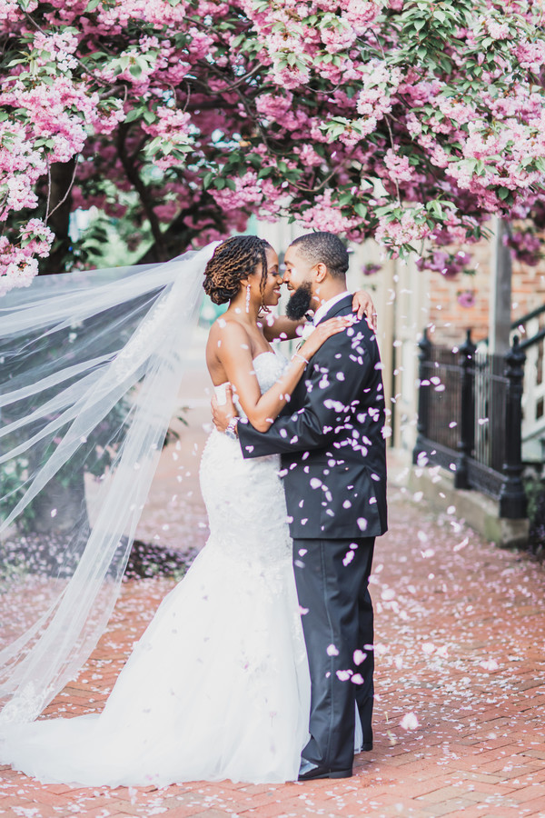 black couple with trees in full bloom