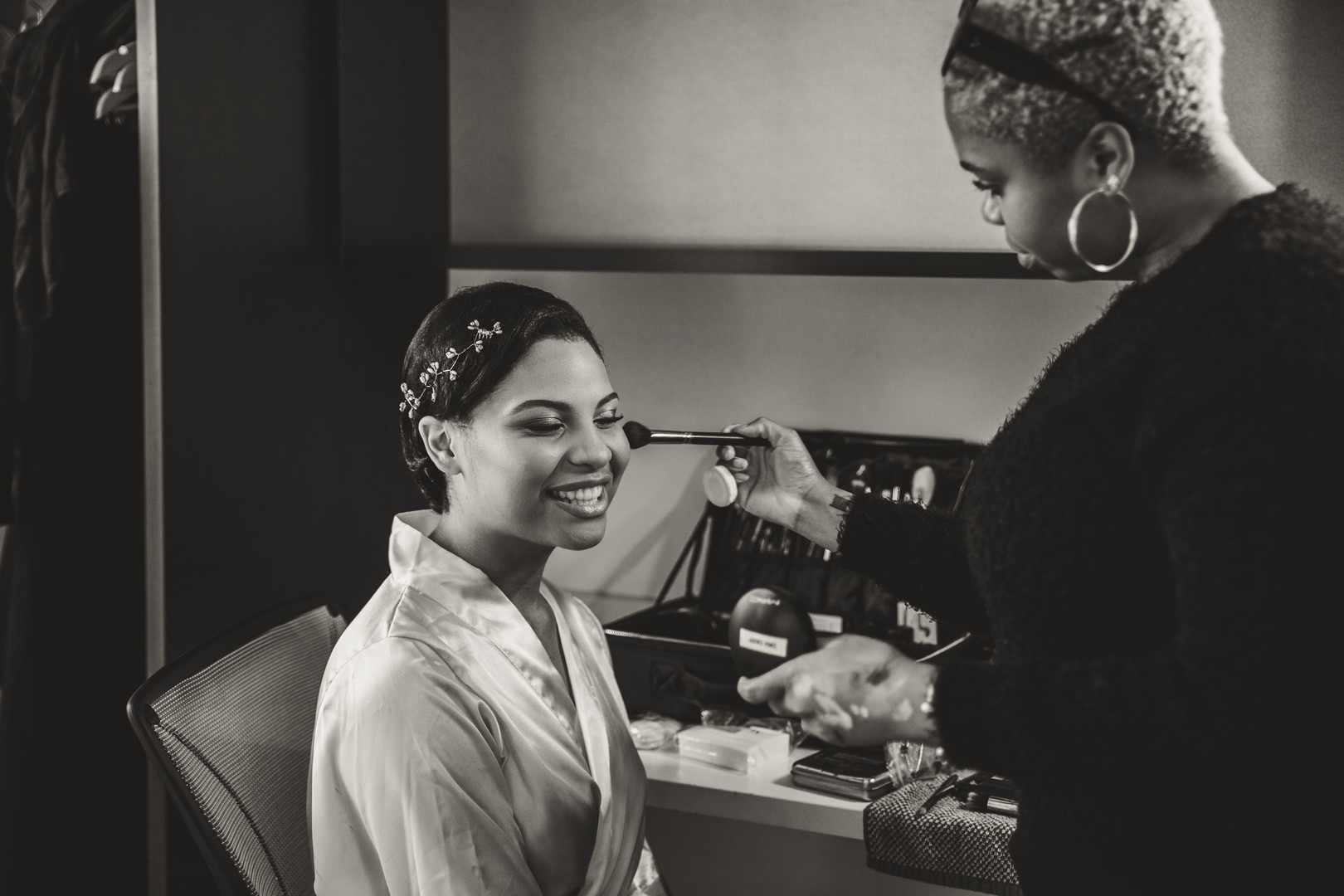 black bride getting makeup done