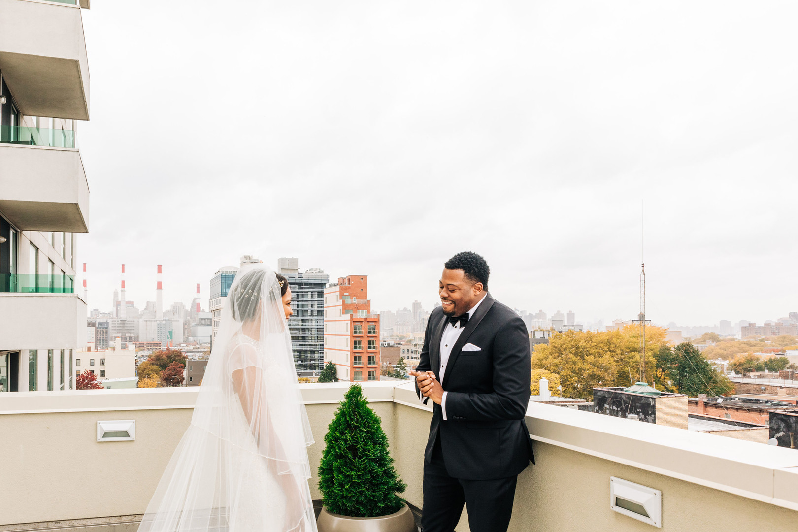 black couple first look on rooftop