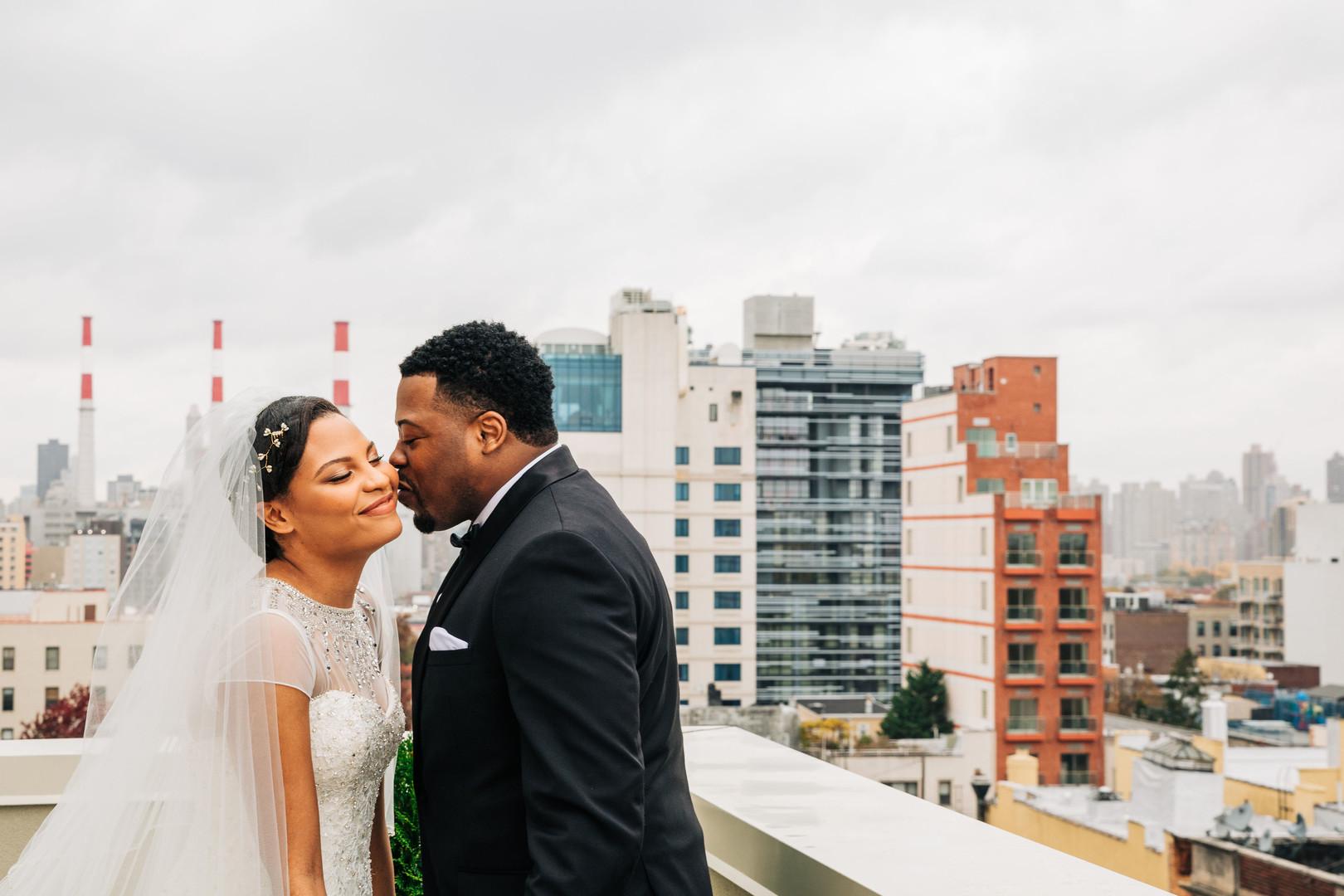black couple sweet wedding day kiss