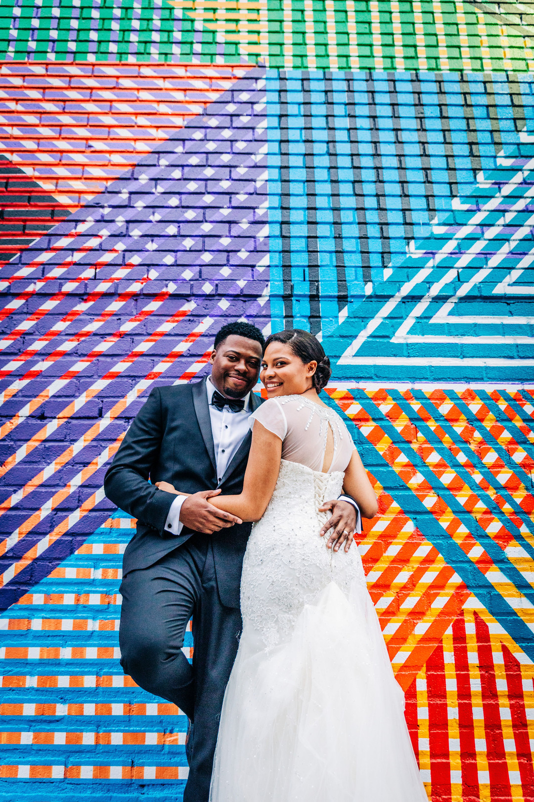black couple with colorful backdrop