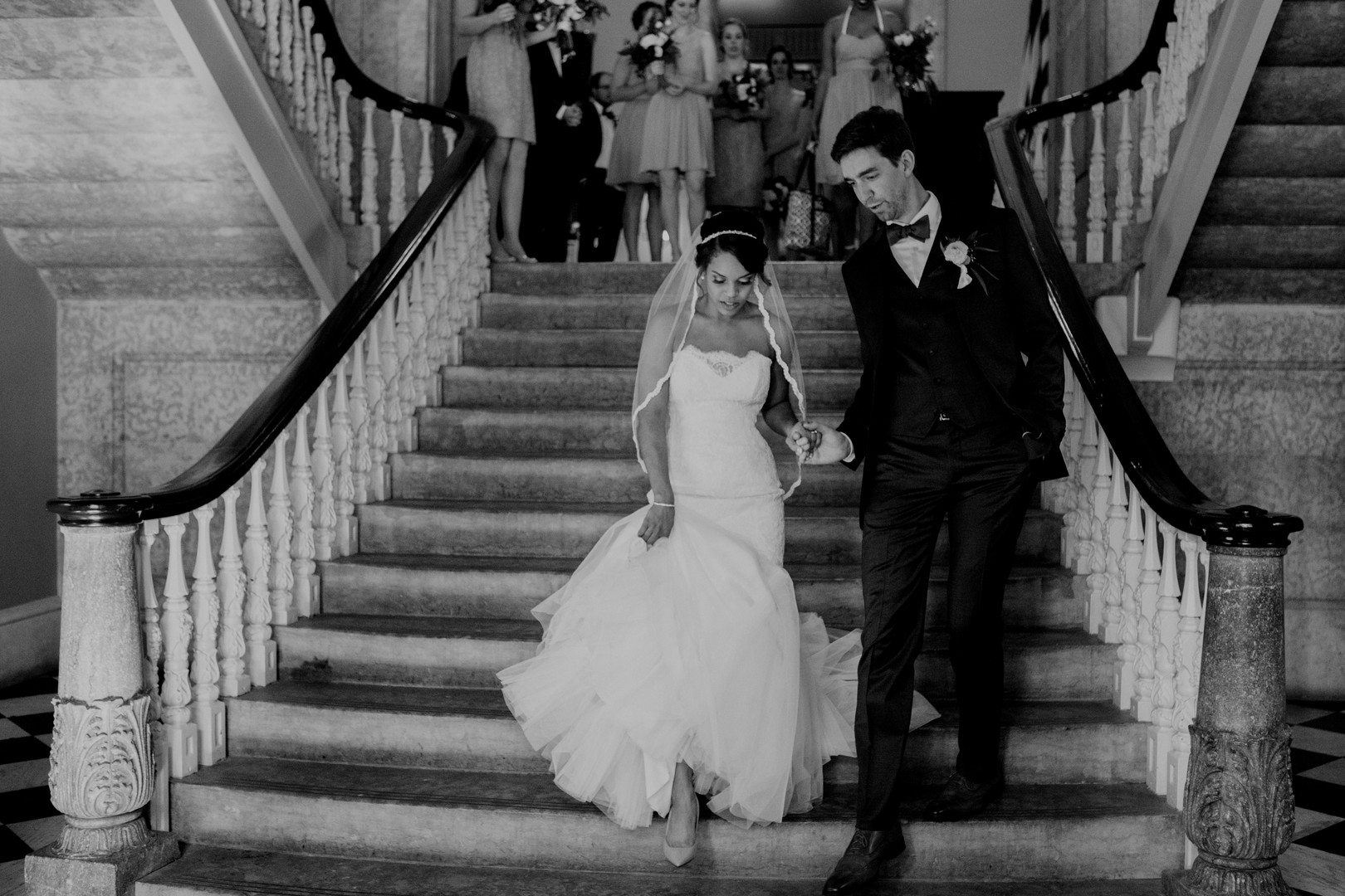 bride and groom on stairs