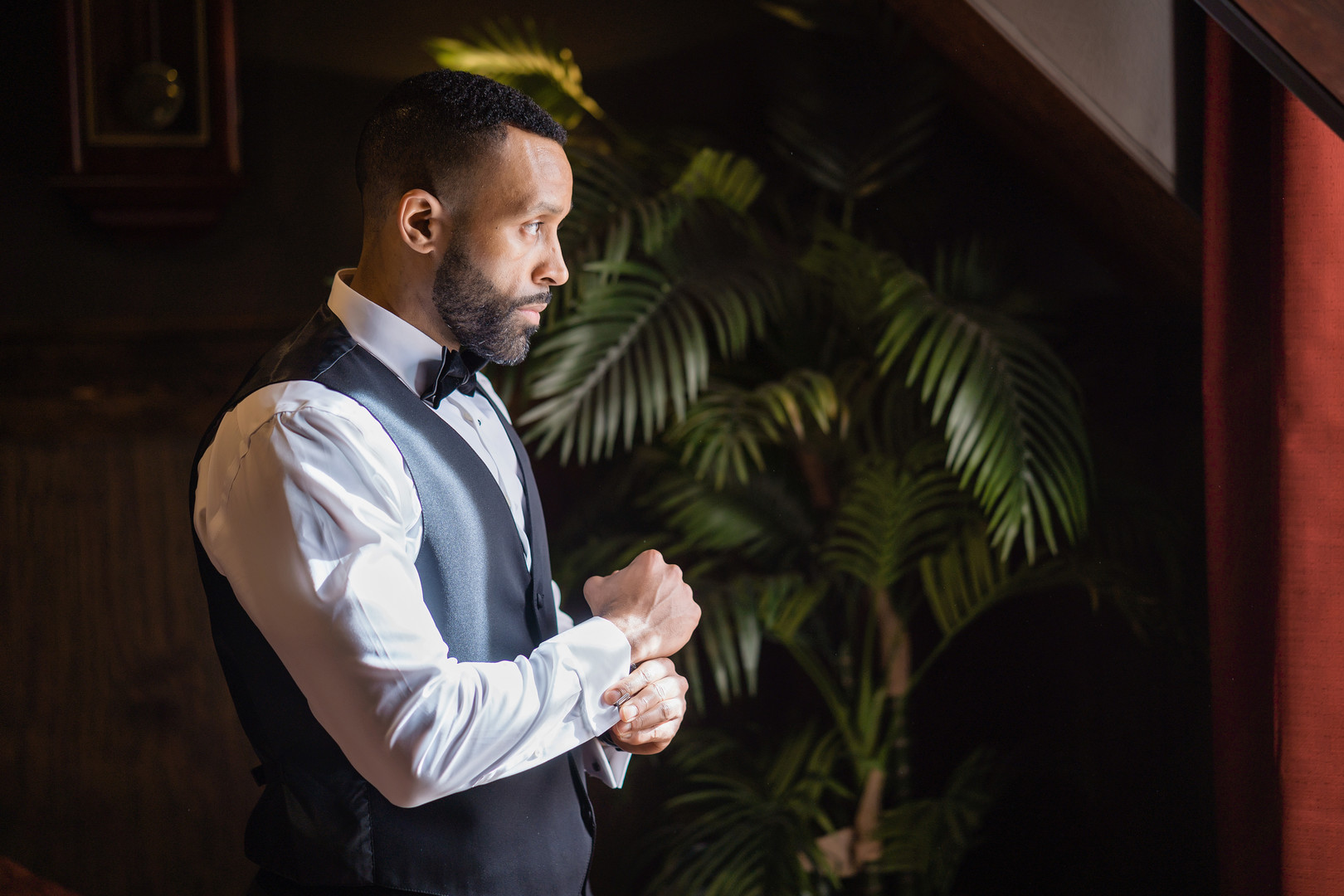 black groom getting ready
