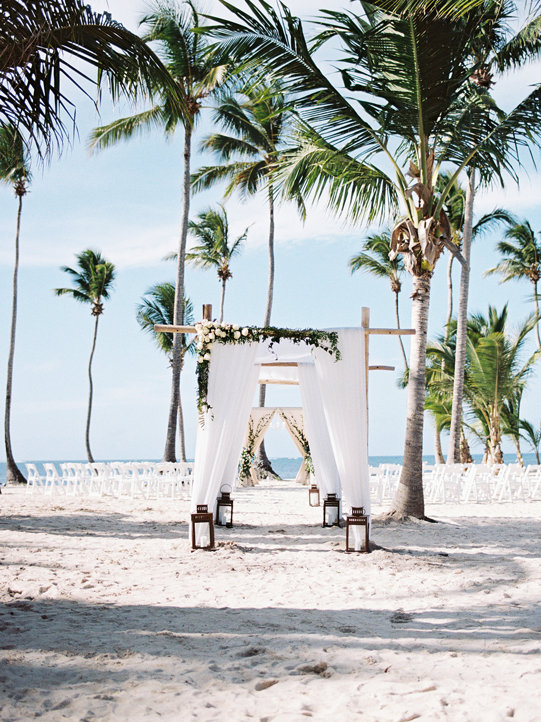 beach wedding white draping and white flowers