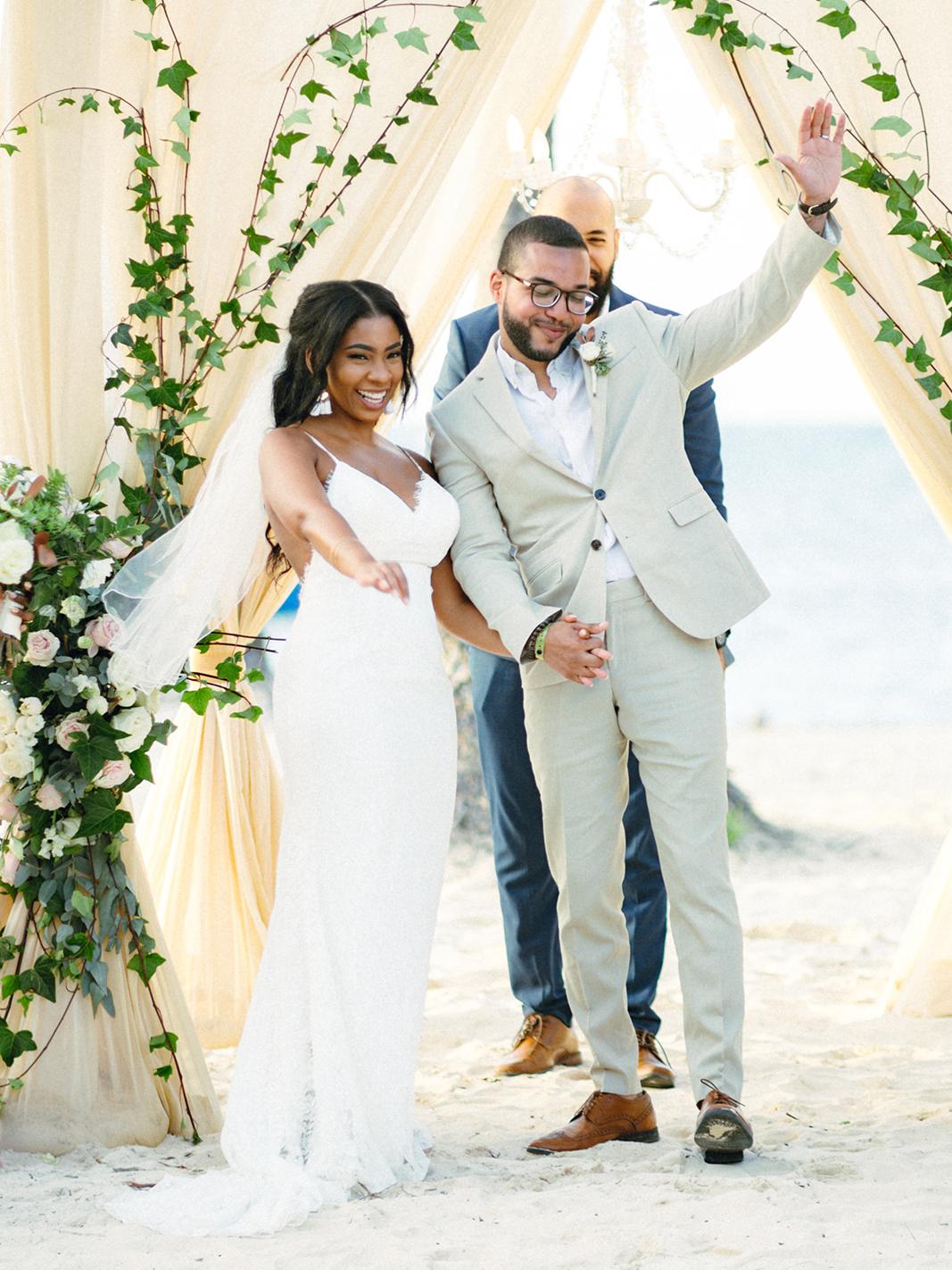 bride and groom celebrating beach wedding