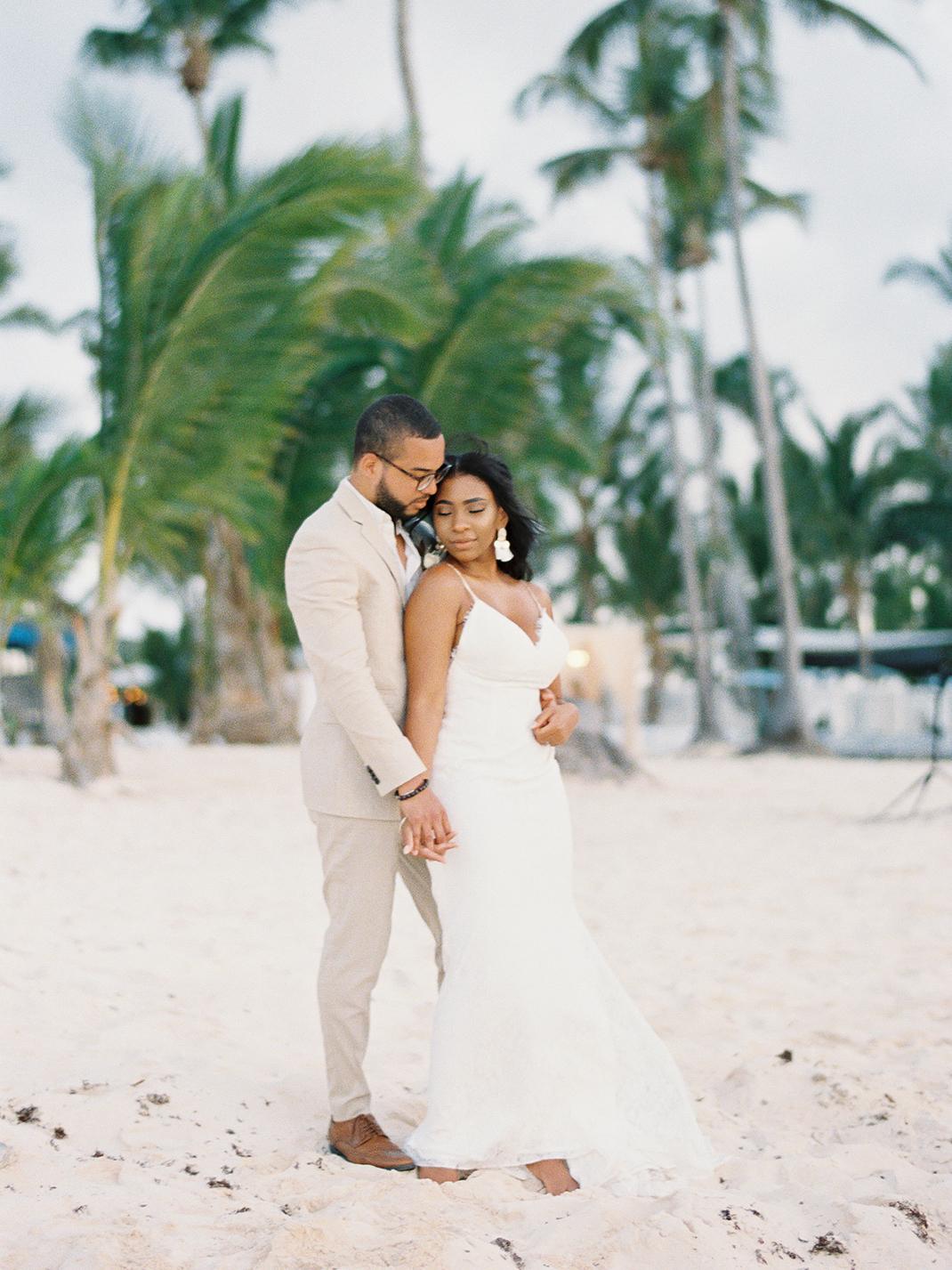 black couple bride and groom on beach