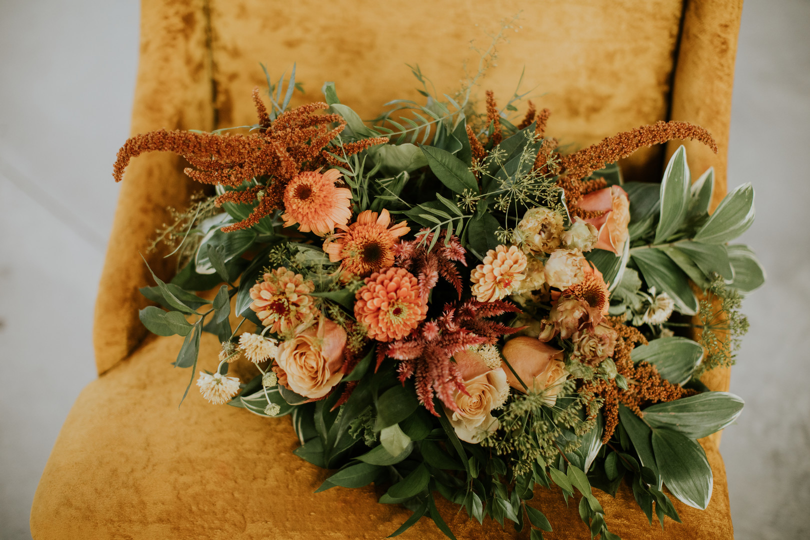 bouquet orange, rust, and yellow