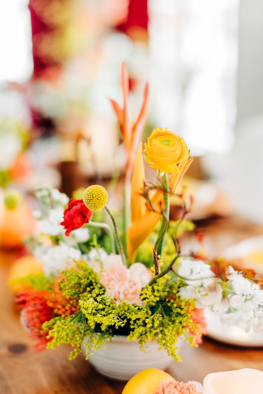 yellow, pink, and red centerpieces