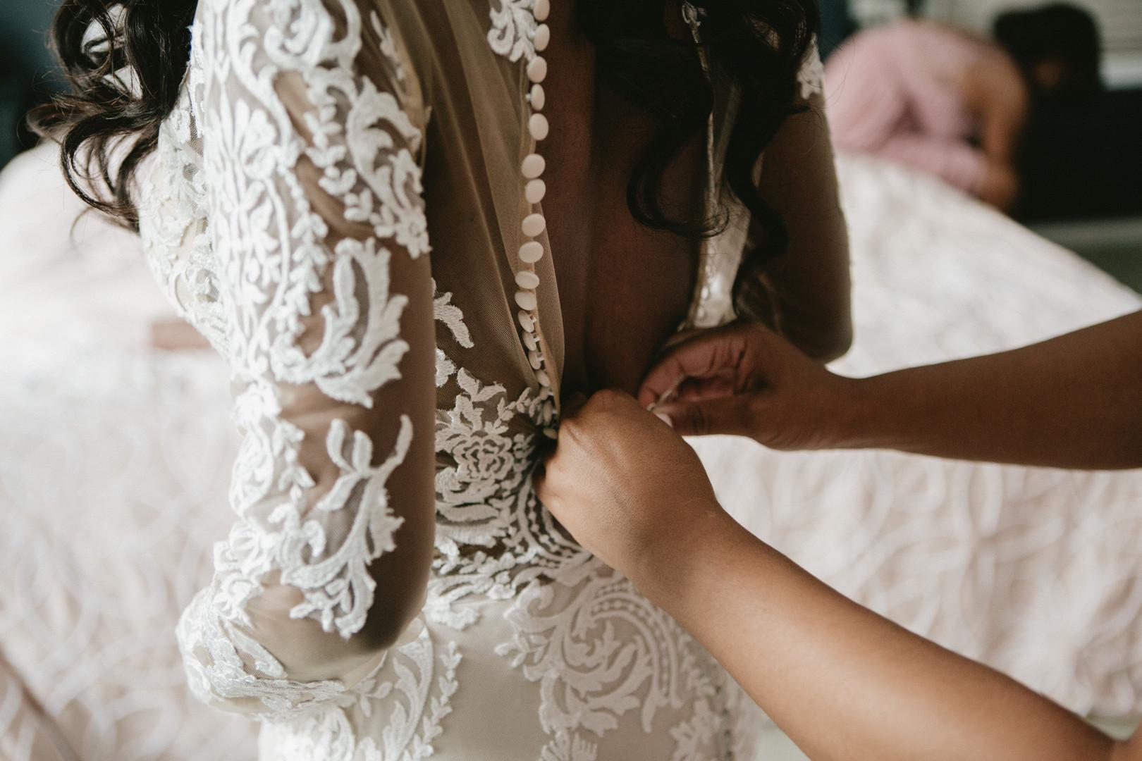 black bride getting dressed