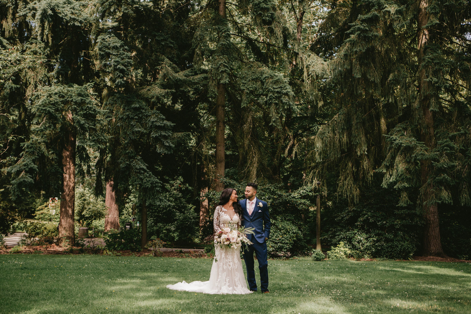 bride and groom with forest backdrop