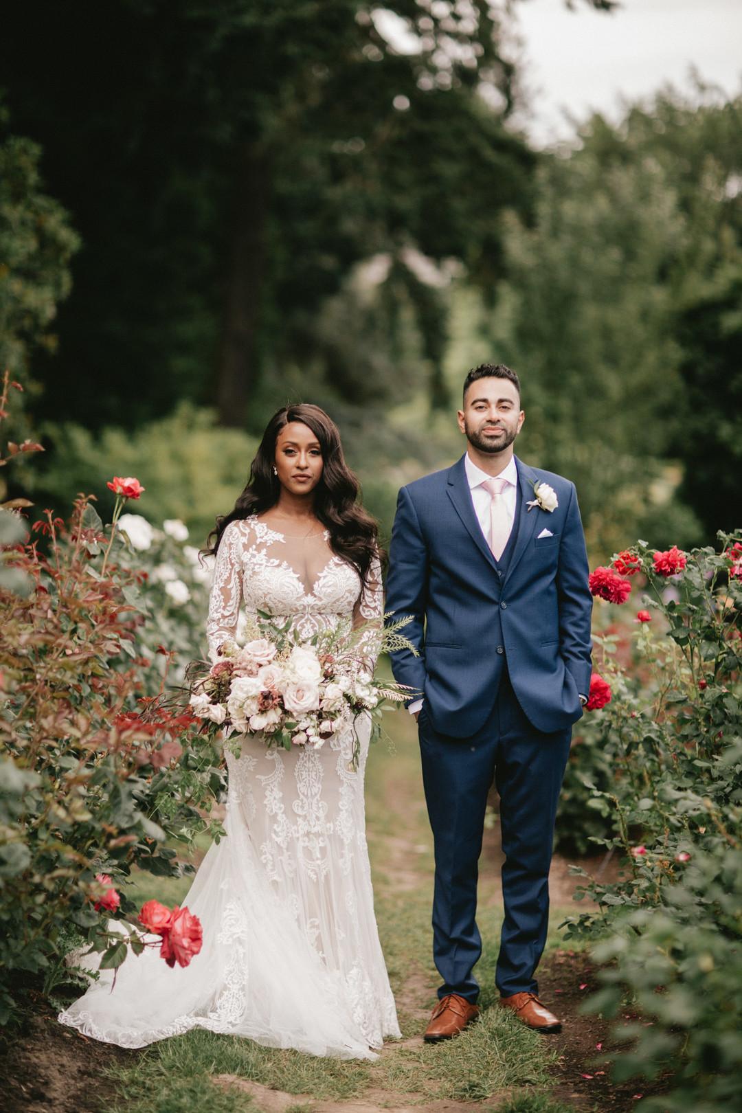 black bride and groom in rose garden