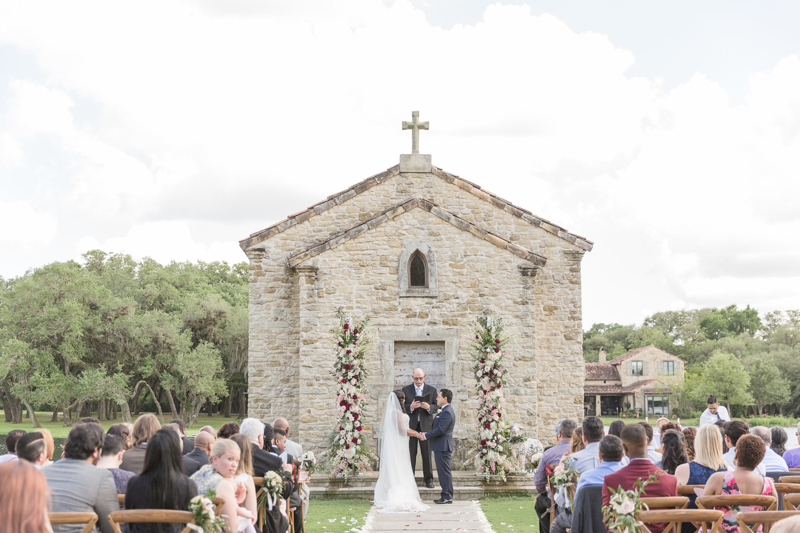 outdoor ceremony with church background