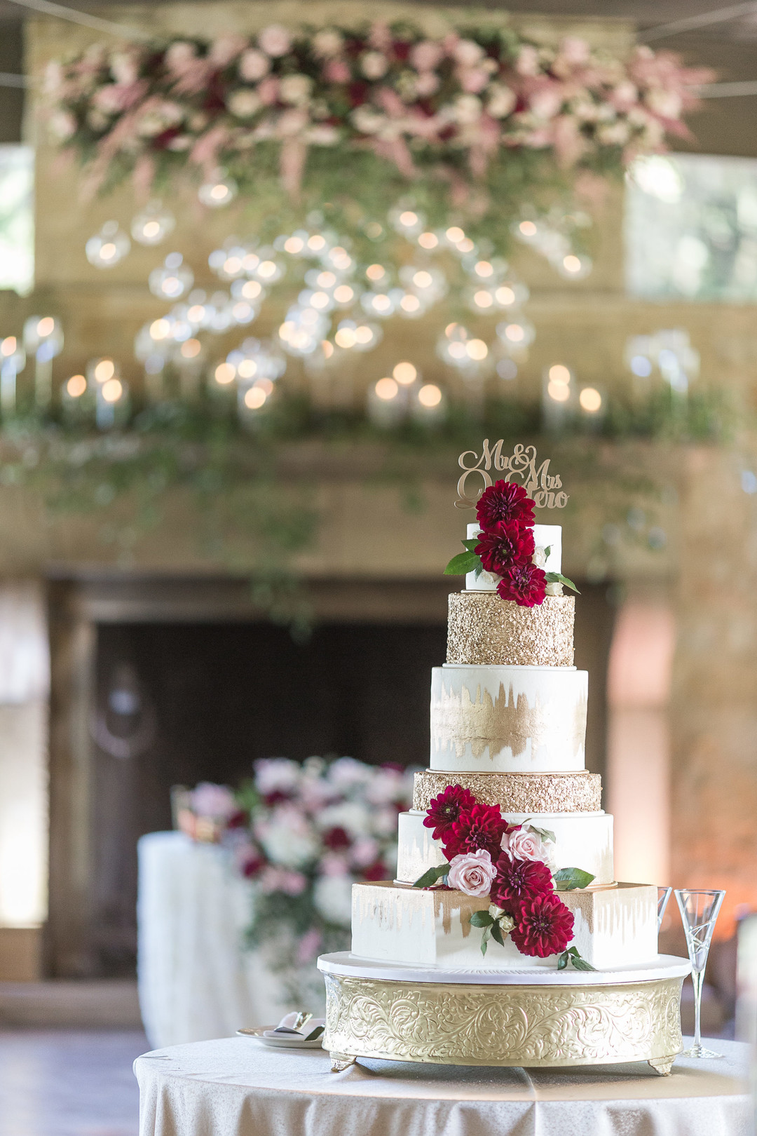 gold and cranberry wedding cake