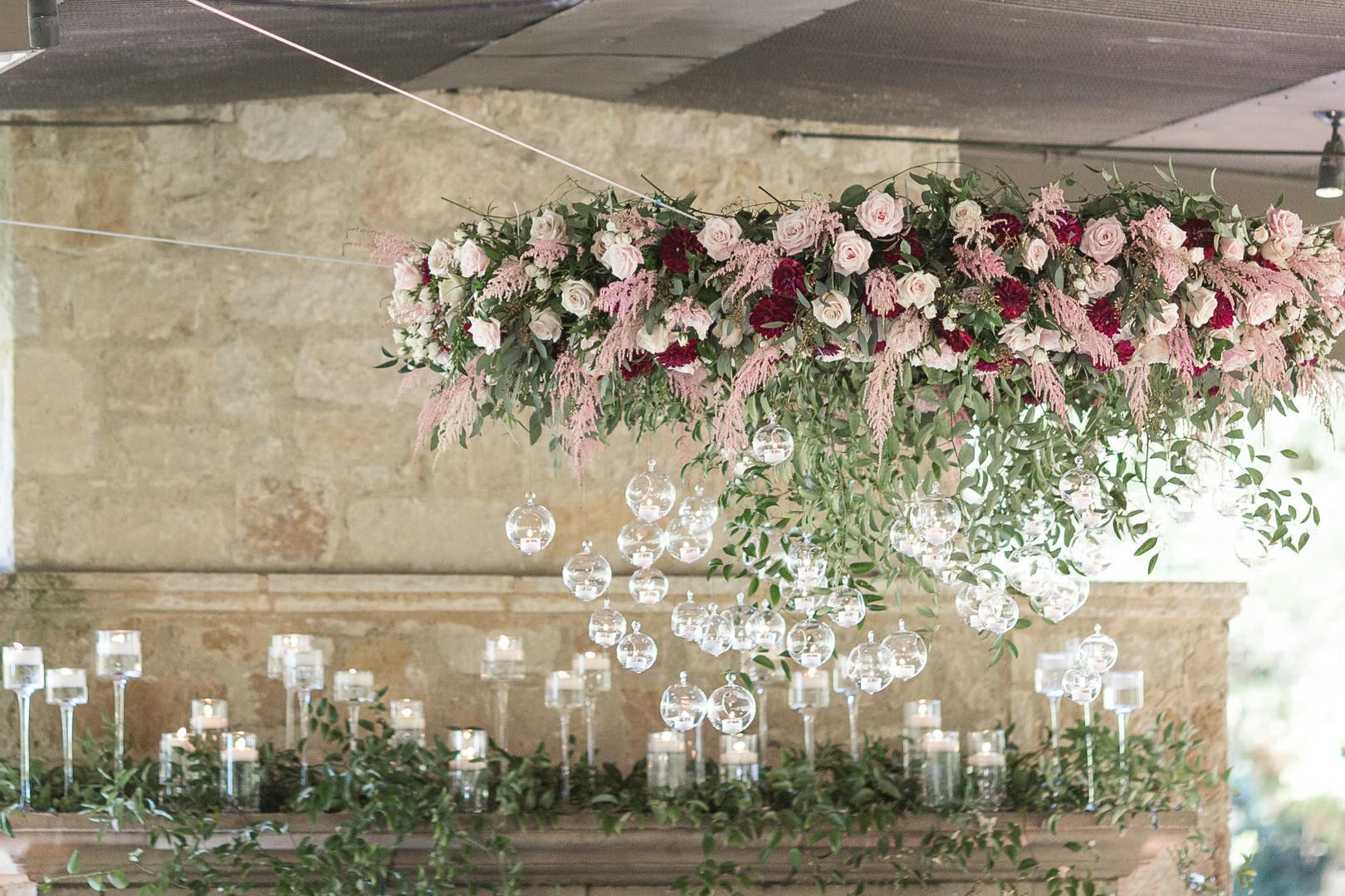 Wedding reception decor hanging florals