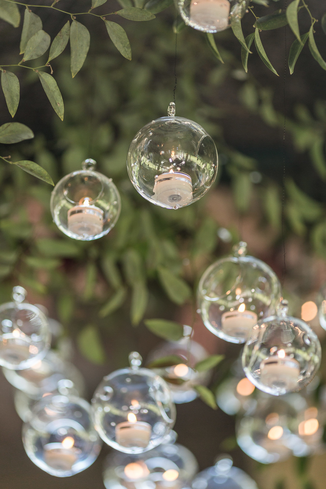 hanging candles in globes