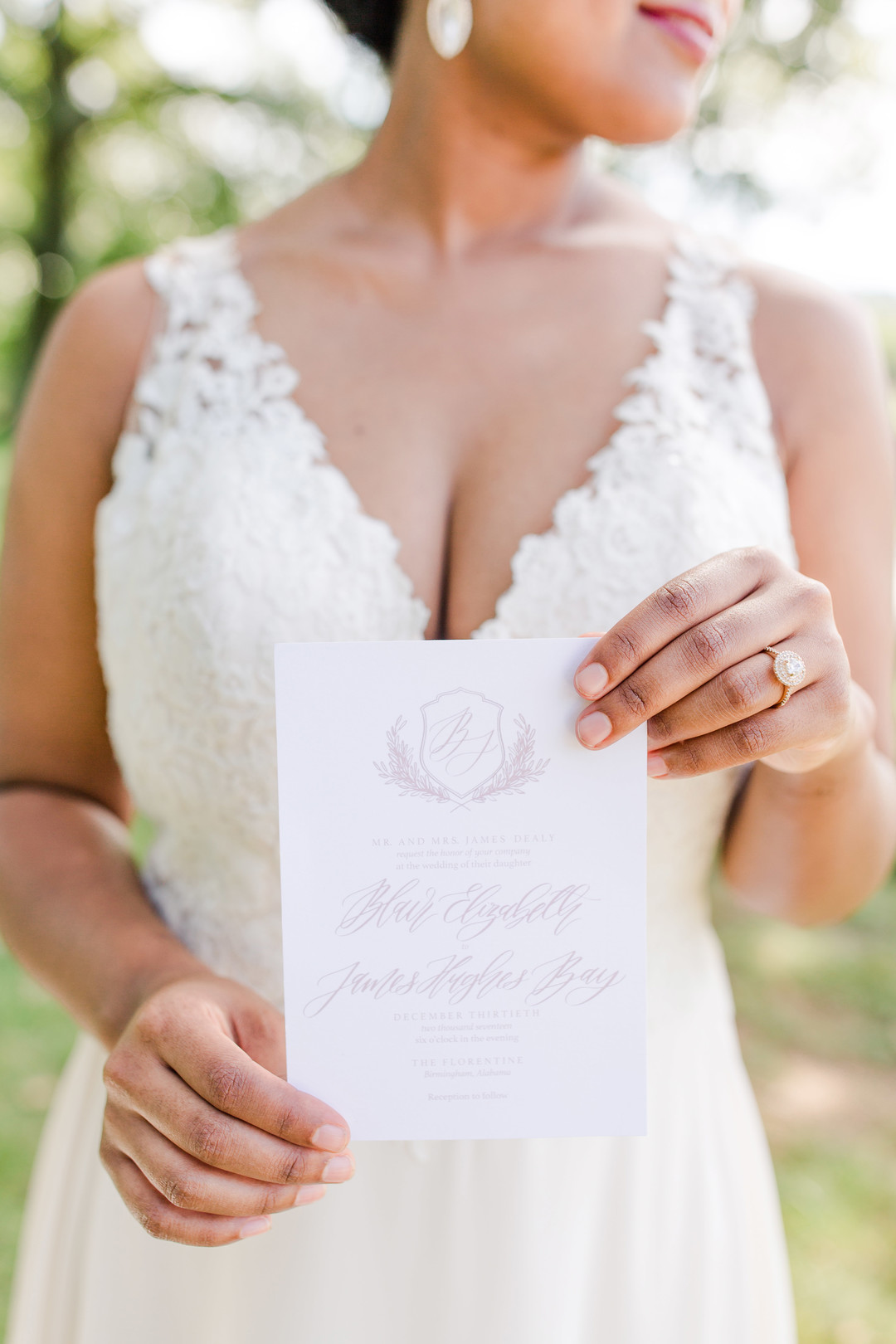bride holding invitation