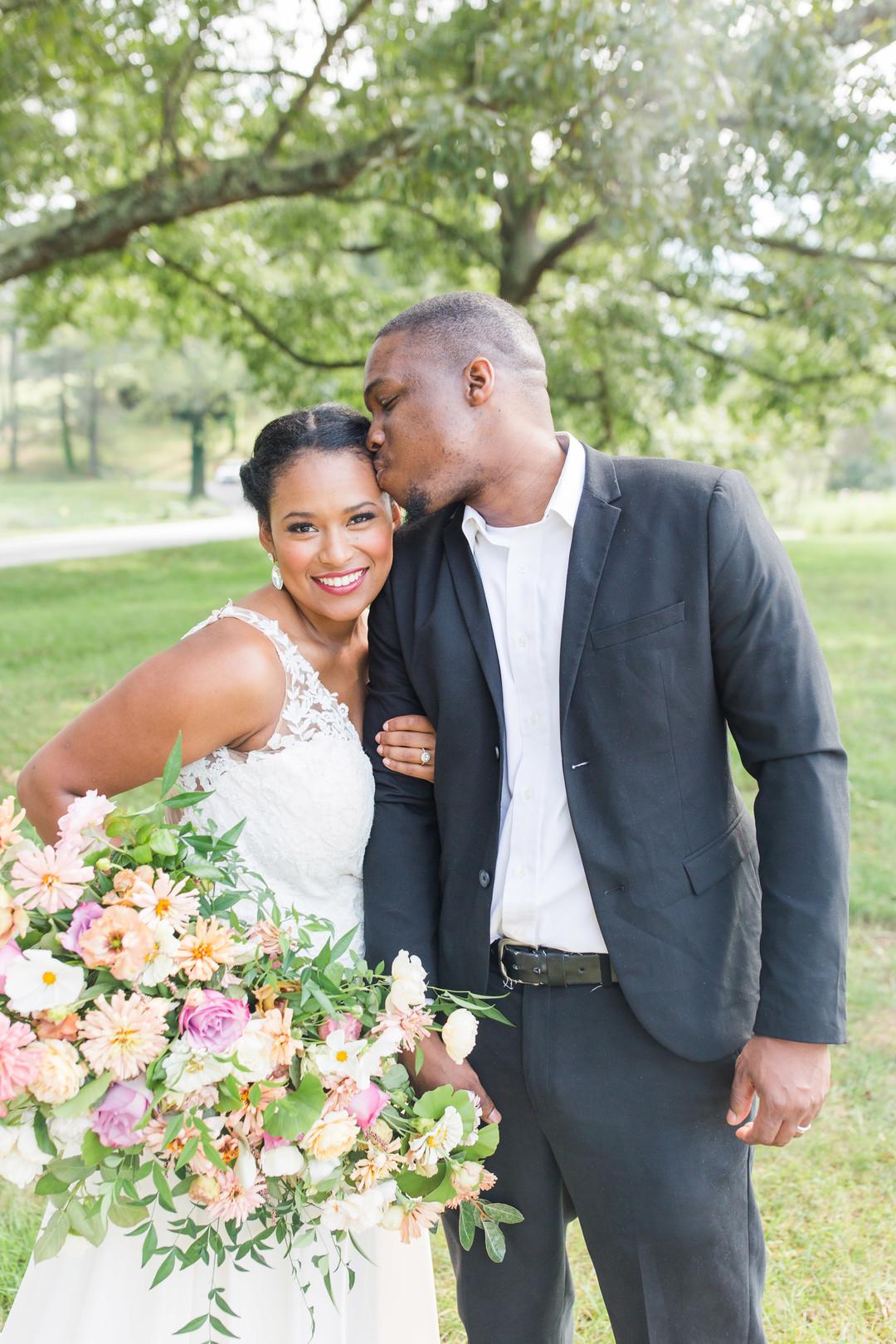 black bride and groom smiling