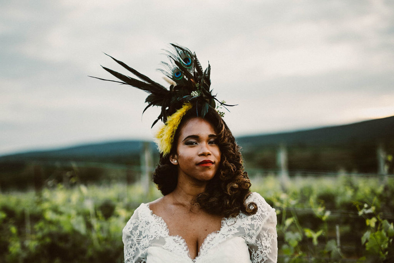 bride with peacock feather hat
