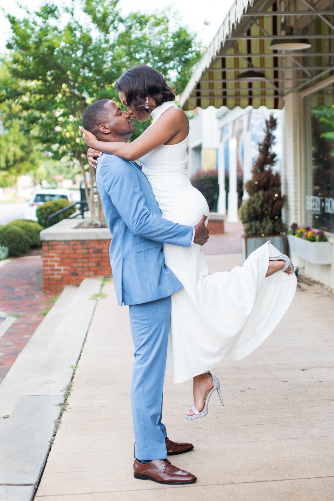 African American bride and groom embrace
