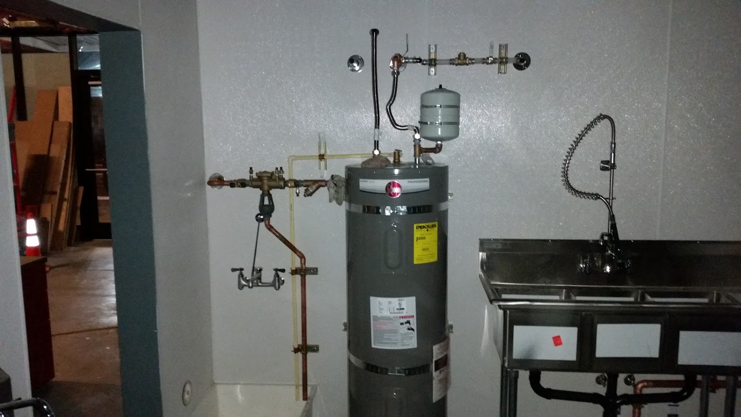 Commercial water heater and reduced pressure backflow device Air Gap Drain into mop sink receptacle