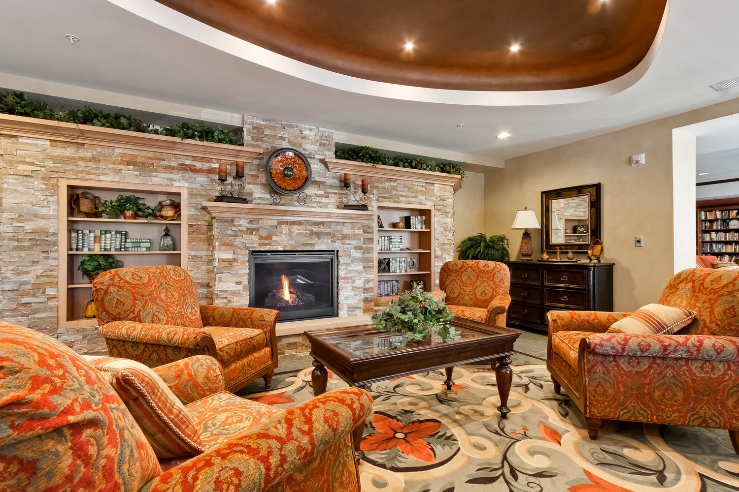 Every Applewood Pointe has a warm and welcoming front lobby with soft chairs and a gas fireplace.