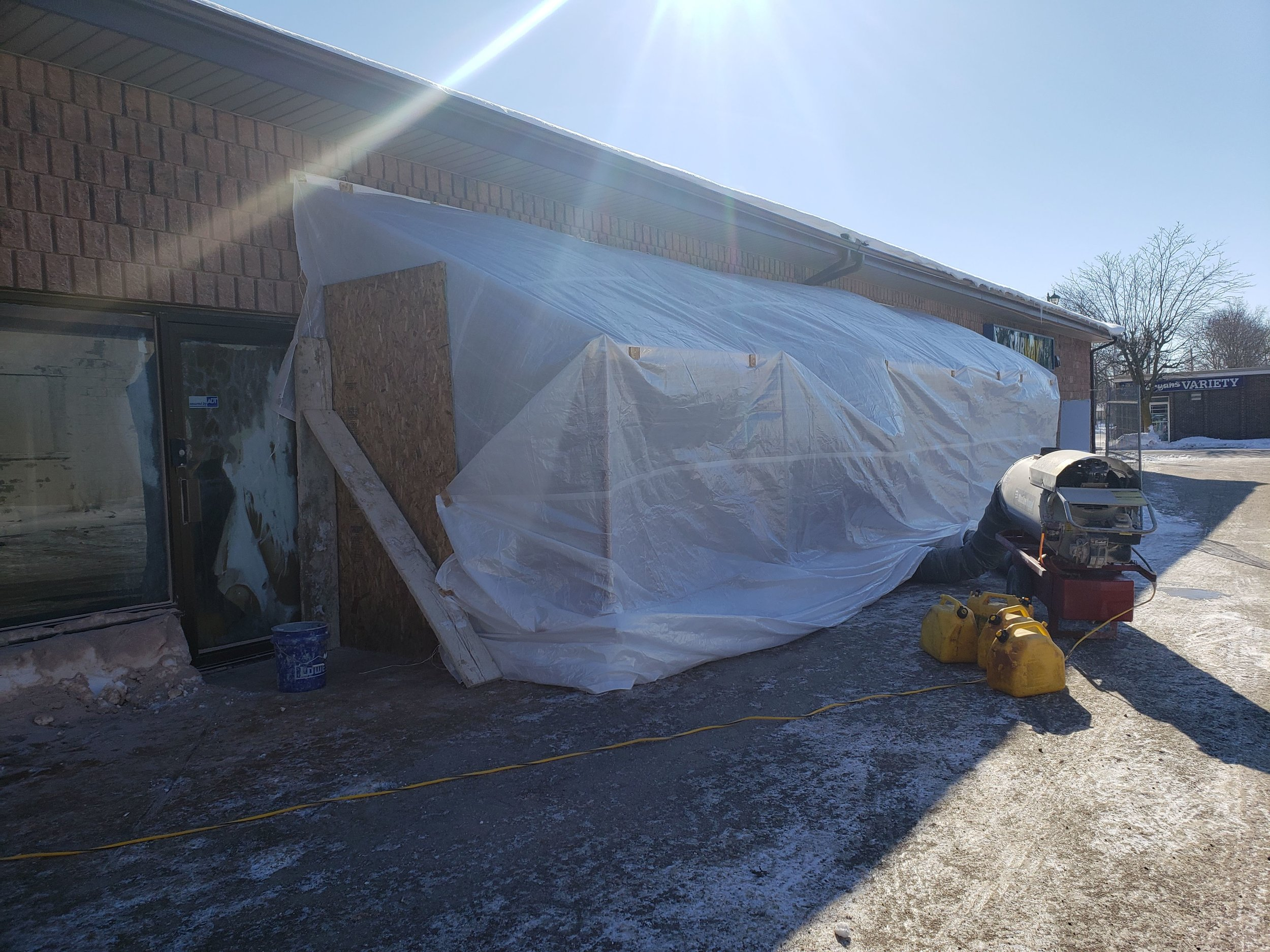 New front windows to reception area are being opened up on another cold day .