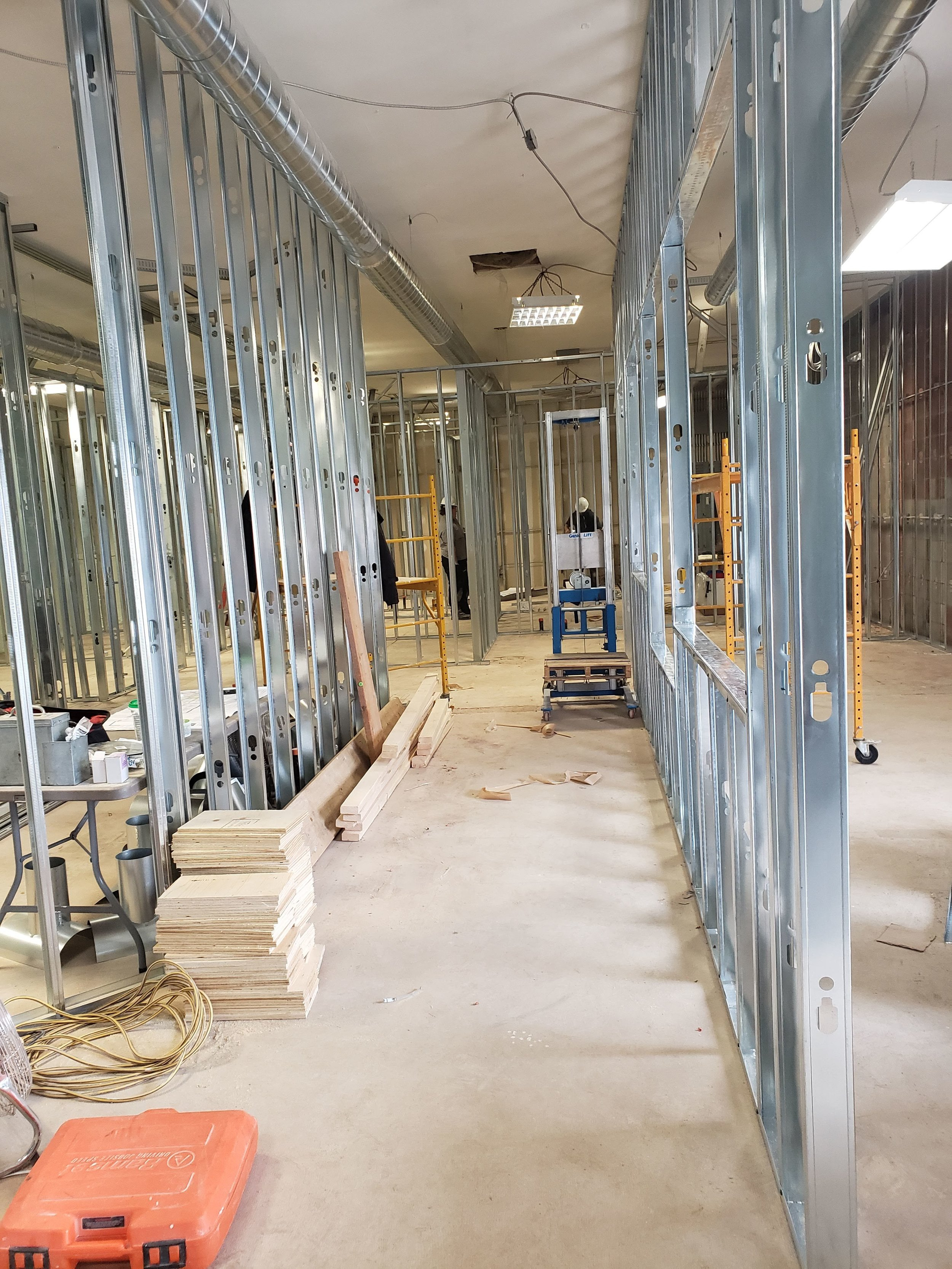 Inside the brain of this whole office ! the reception desk has been framed in!
